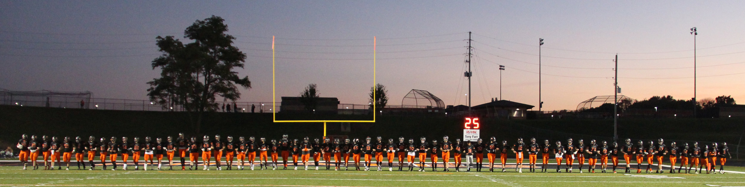 ROSS MARTIN/Citizen photo Platte County's football players took the field in a line with arms interlocked prior to the Class 4 District 8 opener with Winnetonka on Friday, Oct. 21 at Pirate Stadium.