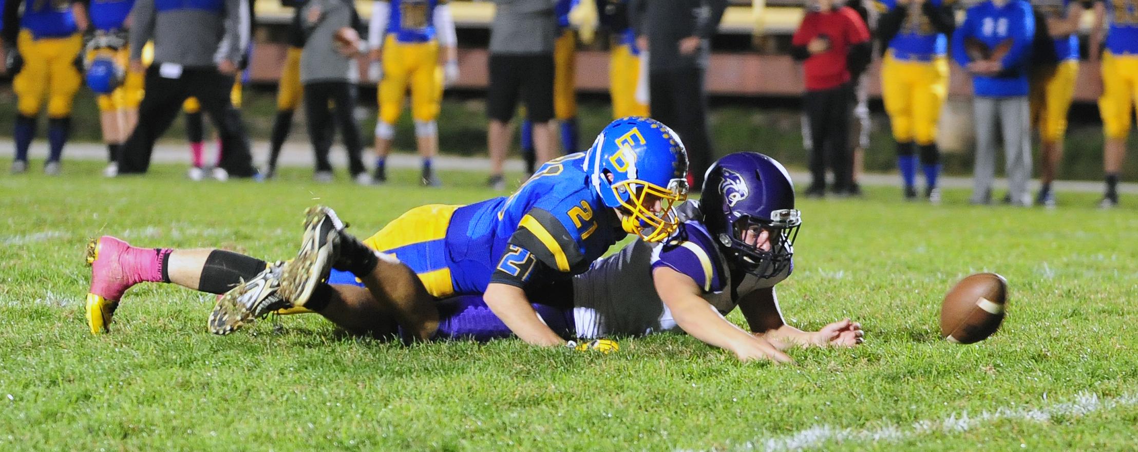 NICK INGRAM/Citizen photo North Platte's Austin Snook, bottom, watches the ball roll away from him during a Class 1 District 7 game Friday, Oct. 21 against East Buchanan in Gower, Mo.