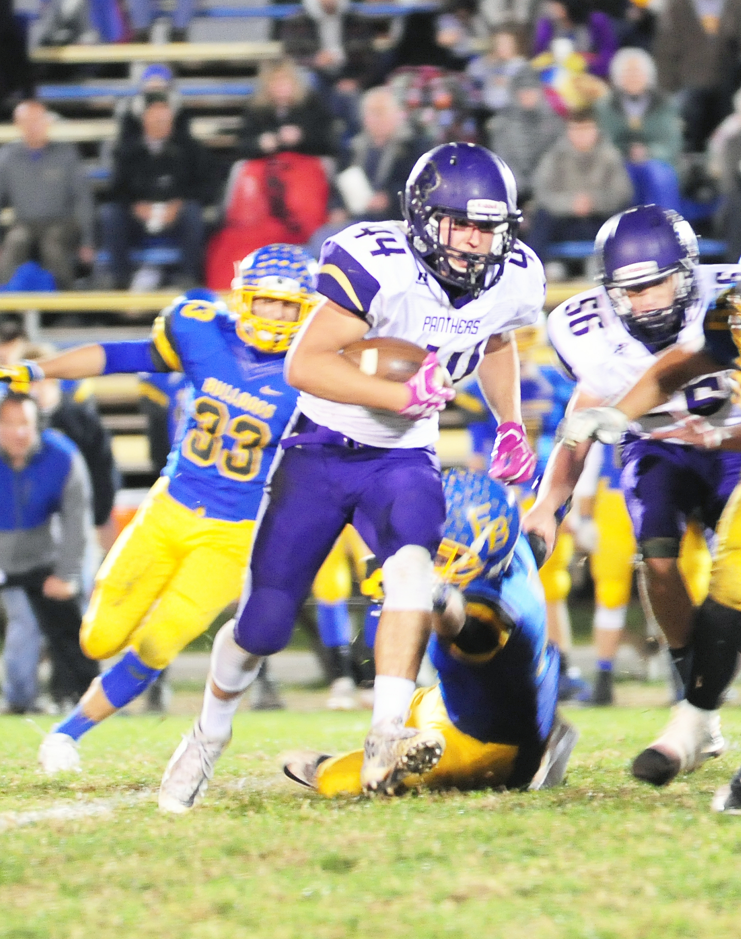 NICK INGRAM/Citizen photo North Platte senior running back Parker Rotterman breaks into the open field on a run against East Buchanan on Friday, Oct. 21. BOTTOM RIGHT: French looks to throw a pass between a pair of blockers.