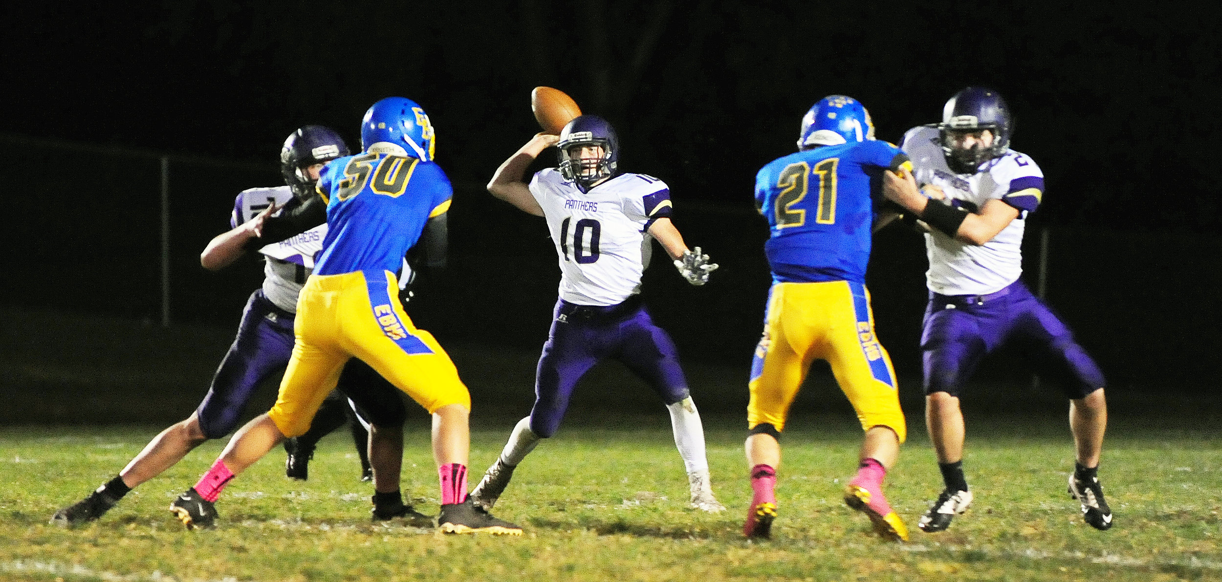 NICK INGRAM/Citizen photo North Platte senior Ben French looks to throw a pass between a pair of blockers against East Buchanan.