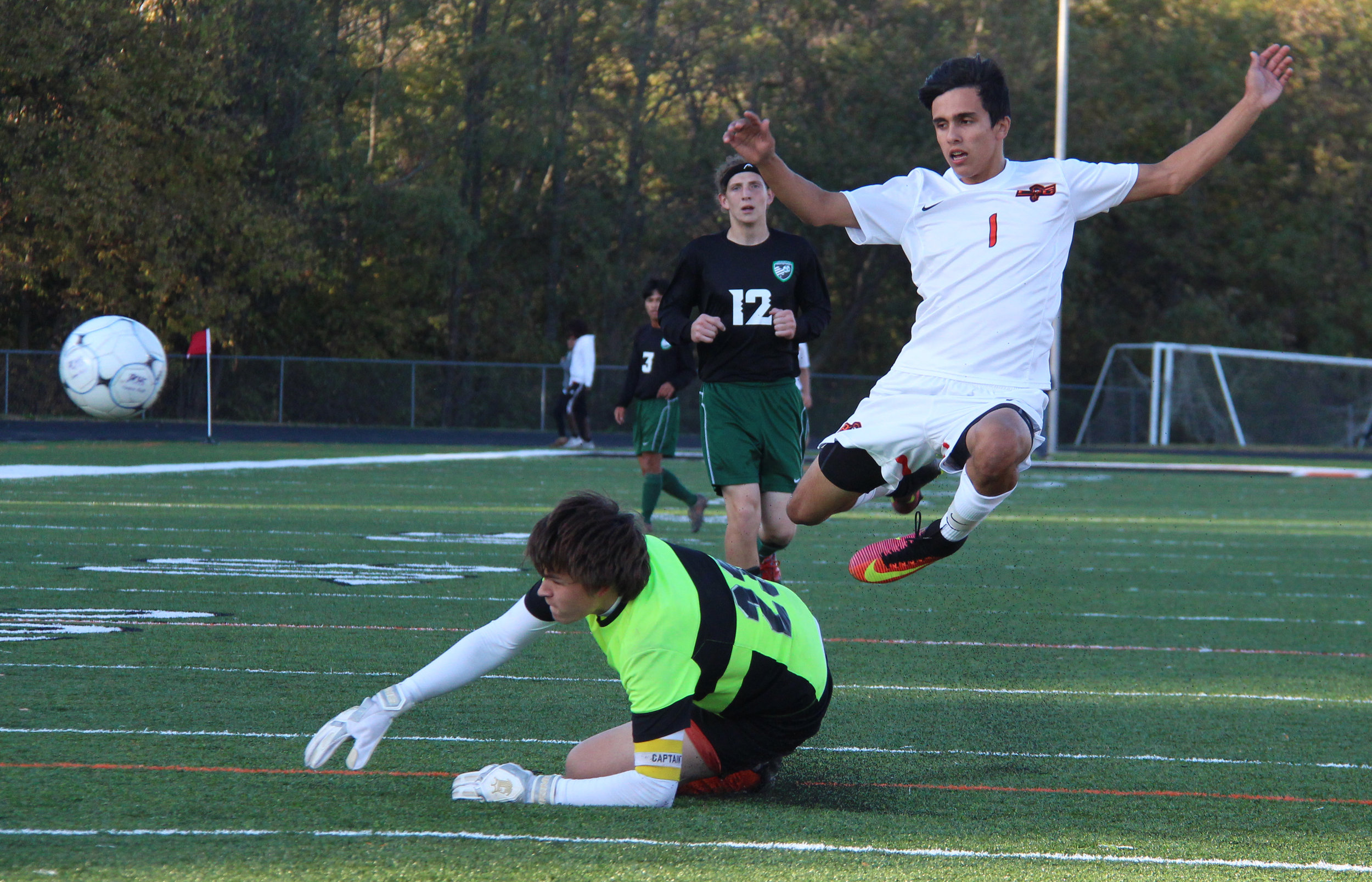 ROSS MARTIN/Citizen photo Platte County junior forward Chandler Peterson (1) jumps to avoid colliding with St. Joseph Lafayette's goalkeeper during a Class 3 District 16 matchup Monday, Oct. 24 at Pirate Stadium.