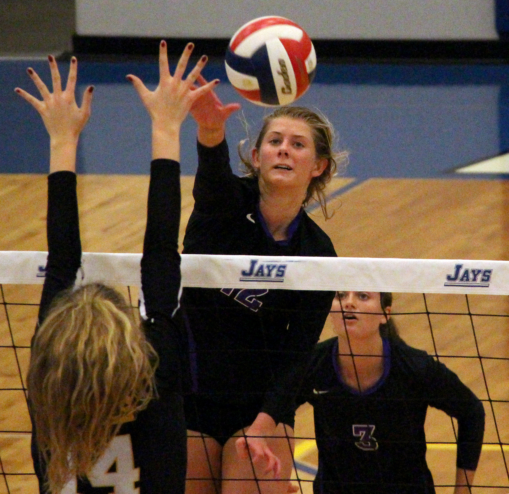 ROSS MARTIN/Citizen photo Park Hill South senior Andi Elley (12) hits a spike over the net against St. Teresa's Academy in a Class 4 quarterfinal played Saturday, Oct. 22 at Liberty Fieldhouse in Liberty, Mo.
