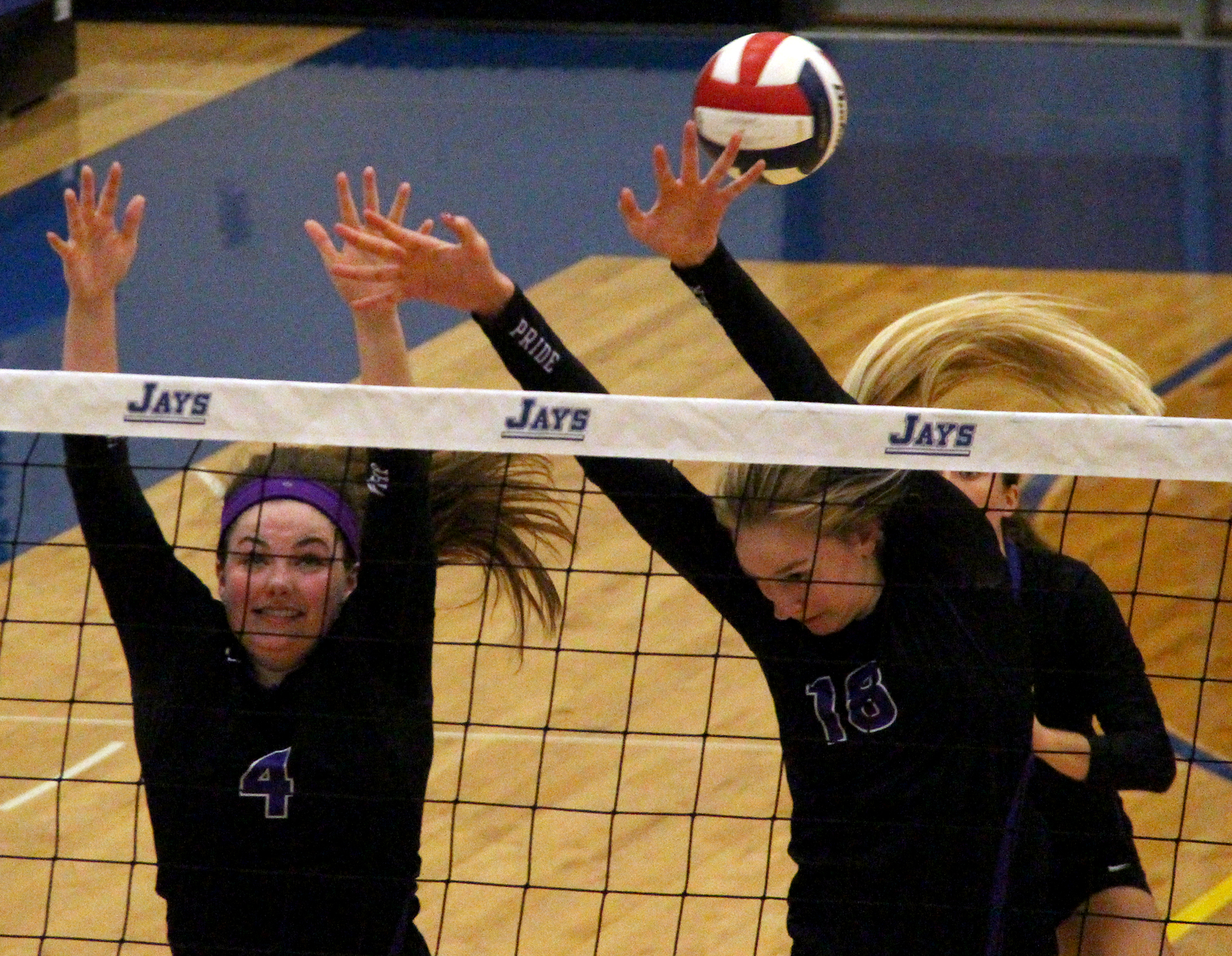 ROSS MARTIN/Citizen photo Park Hill South senior Allison Sadler (4) and junior Annika Welty (18) go up for a block against St. Teresa's Academy on Saturday, Oct. 22 in Liberty, Mo.