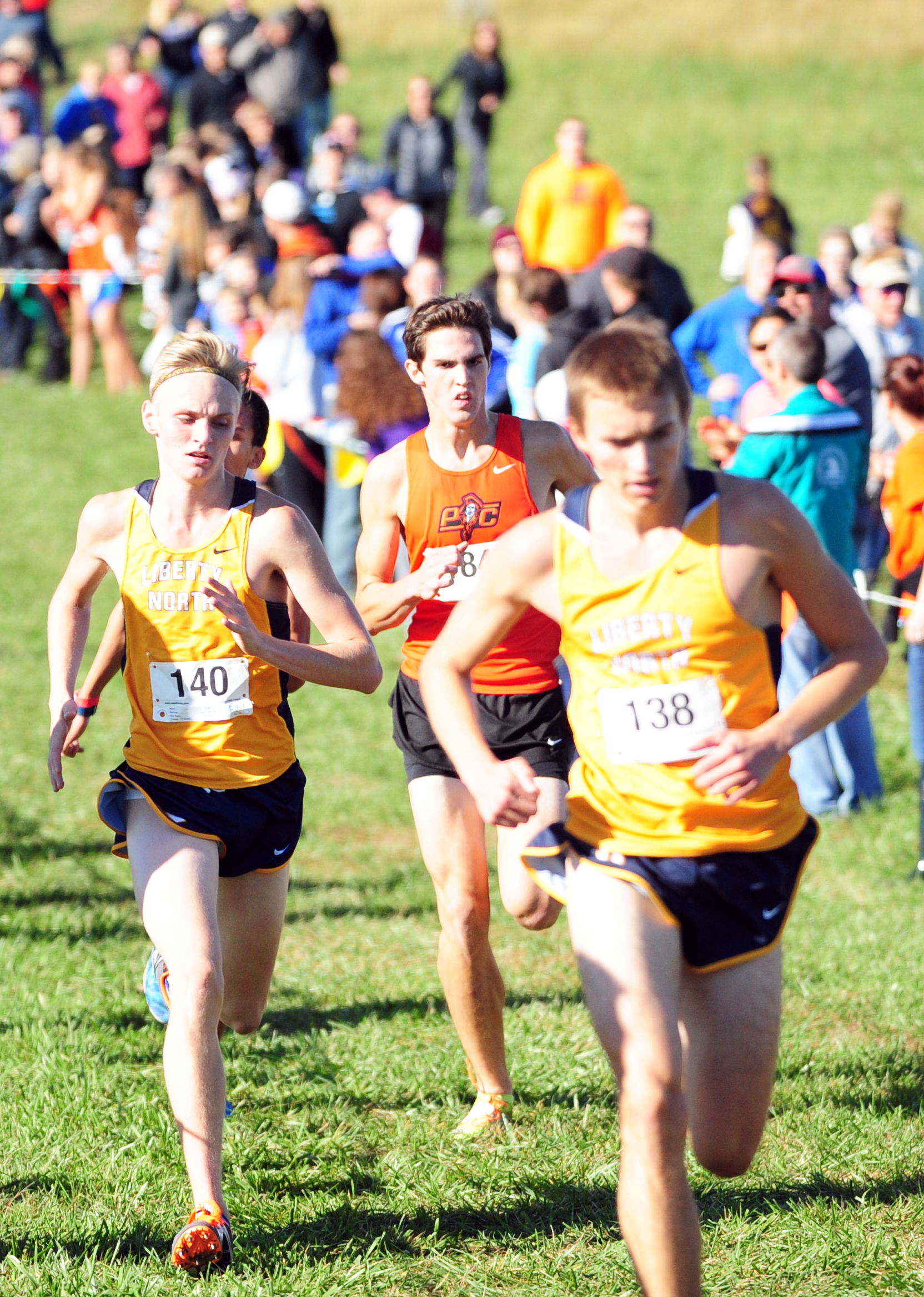 NICK INGRAM/Citizen photo Platte County sophomore Keegan Cordova, center, runs in a pack during the Class 4 District 8 race on Saturday, Oct. 22 at Platte Ridge Park.