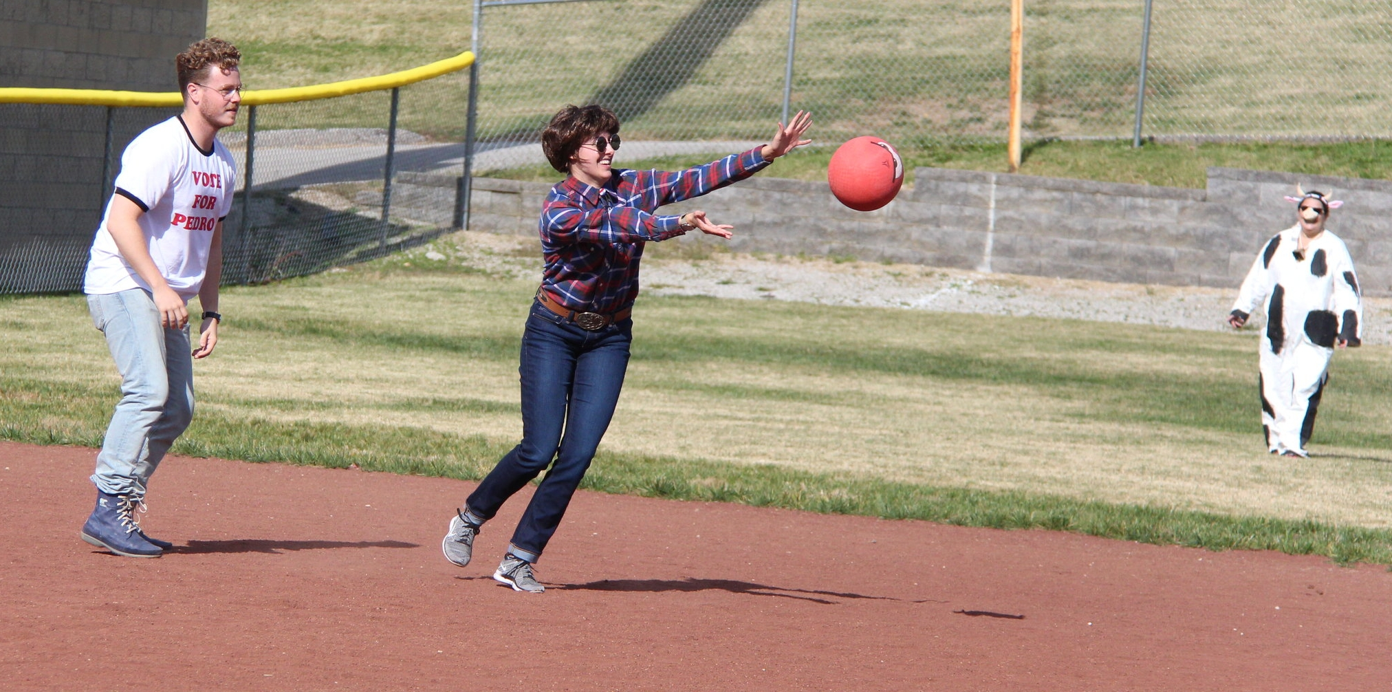 "ROSS MARTIN/Citizen photo Rachelle West, center, makes a throw to second during a costume kickball game played Saturday, Oct. 29 at Harrel Ferrel Park in Platte City. She was dressed as Pedro from the movie ""Napoleon Dynamite."" Jake Baker, left, dressed up as the title character."