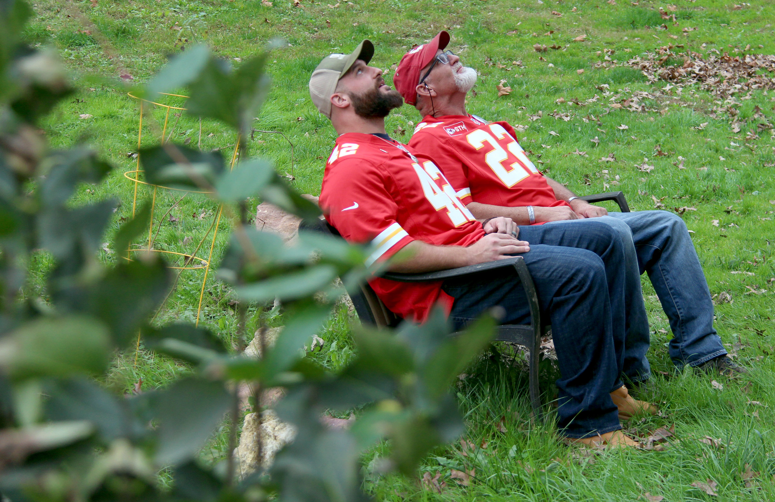 ROSS MARTIN/Citizen photo Kansas City Chiefs fullback Anthony Sherman, left, and Patrick Farnan look up at a tree planted in the backyard of the Farnans' home in Weston, Mo. Patrick Farnan told Sherman that he planted the tree 11 years ago after son Colby Farnan was killed while serving in the U.S. Army.