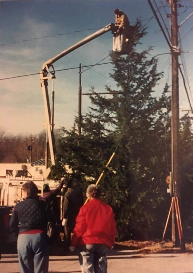 Contributed photo Crews work to set up the Mayor's Christmas Tree for the annual Christmas in Dearborn celebration in this 2001 file photo. Members of the community have revived the tradition for this year.