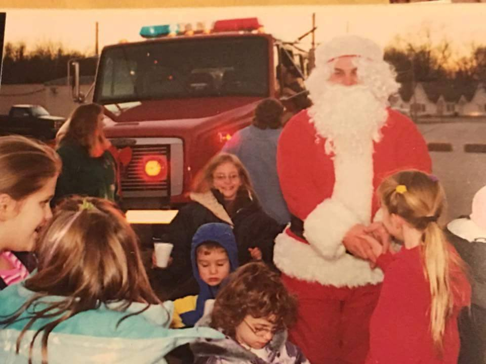 Contributed photo Santa Claus comes down off of a Dearborn Area Fire Protection District truck to greet children during the 2001 Christmas in Dearborn celebration in Dearborn, Mo. The once annual event went away in recent years but will be revived this weekend.