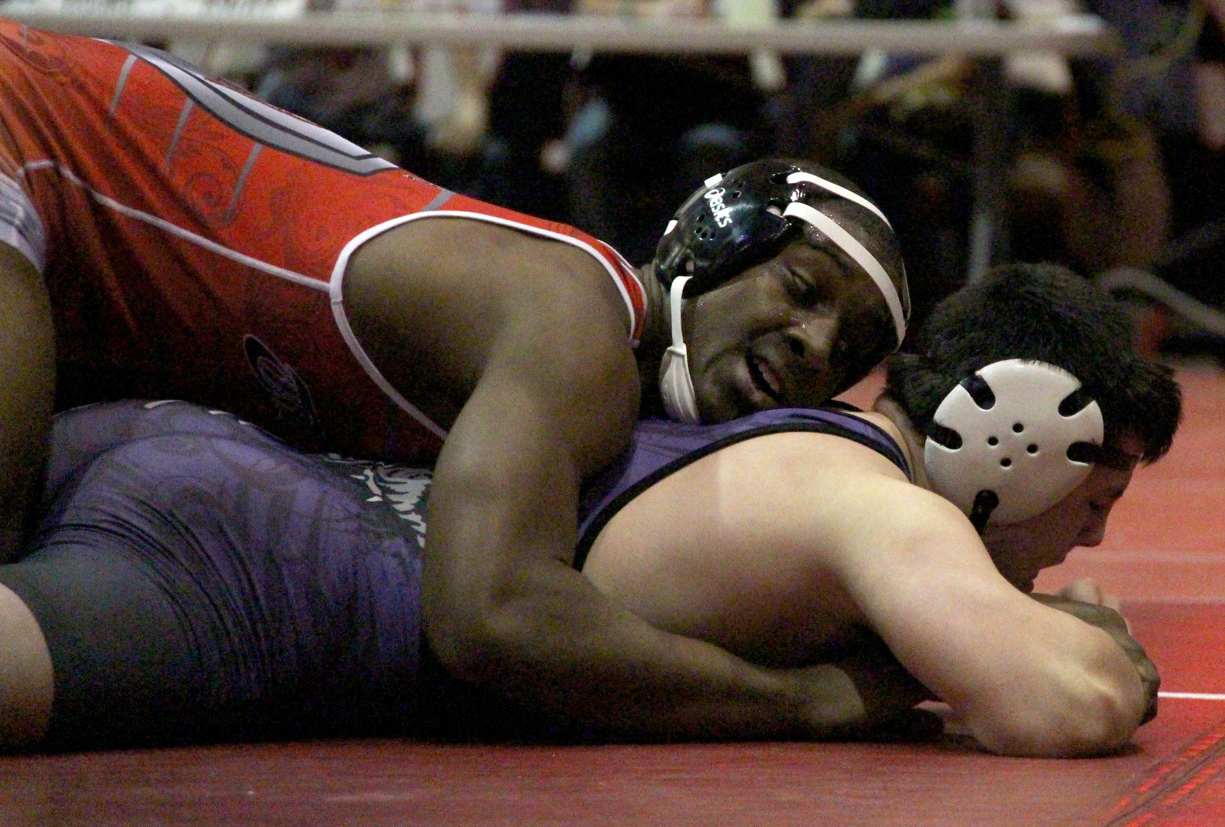 ROSS MARTIN/Citizen photo Park Hill senior TJ Hullaby, top, controls Kearney's Chopper Mordecai in a 182-pound match during the Park Hill Duals tournament held Saturday, Dec. 3 at Park Hill High School. Park Hill won all five duals and won the championship.
