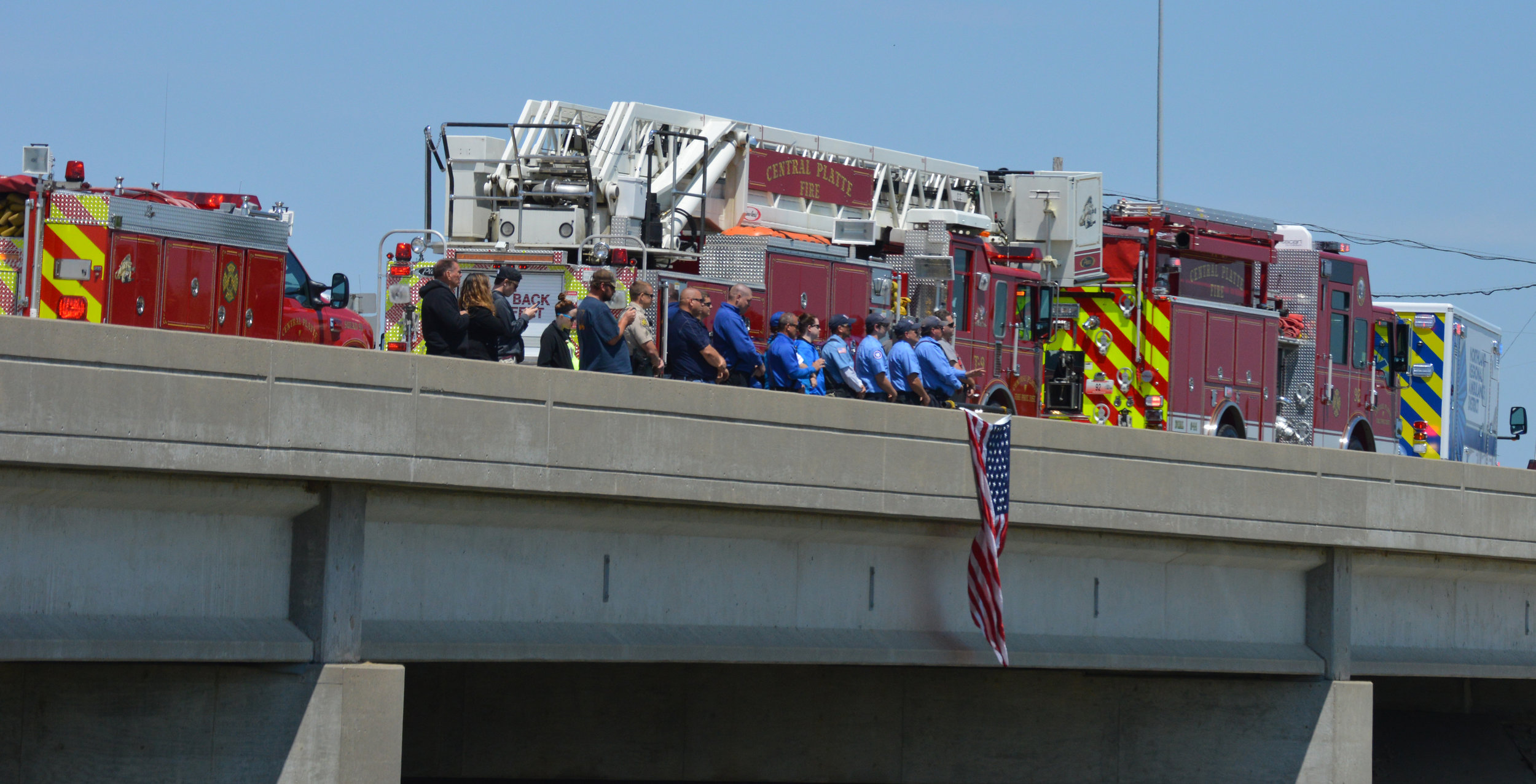 BRENT ROSENAUER/Citizen photo Members of the Platte County Sheriff's Office, Central Platte Fire Department and Northland Regional Ambulance District along with citizens stand on the Highway 92 overpass above Interstate 29 on Saturday, May 14 in Platte City, waiting for the funeral procession of Kansas City (Kan.) Police Department detective and Weston, Mo. native Brad Lancaster.