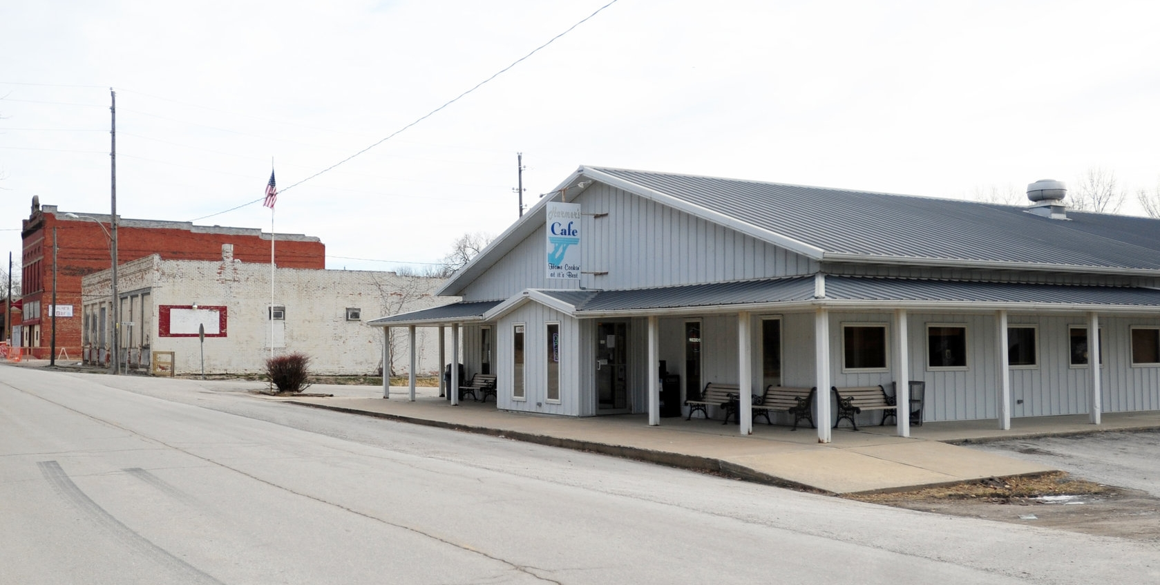 NICK INGRAM/Citizen photo Harmer's Cafe, right, in Edgerton, Mo. recently began serving beer and added bar hours. The decision came after Gracie's Bar, brick building at rear, closed in March due to structural issues with the building.
