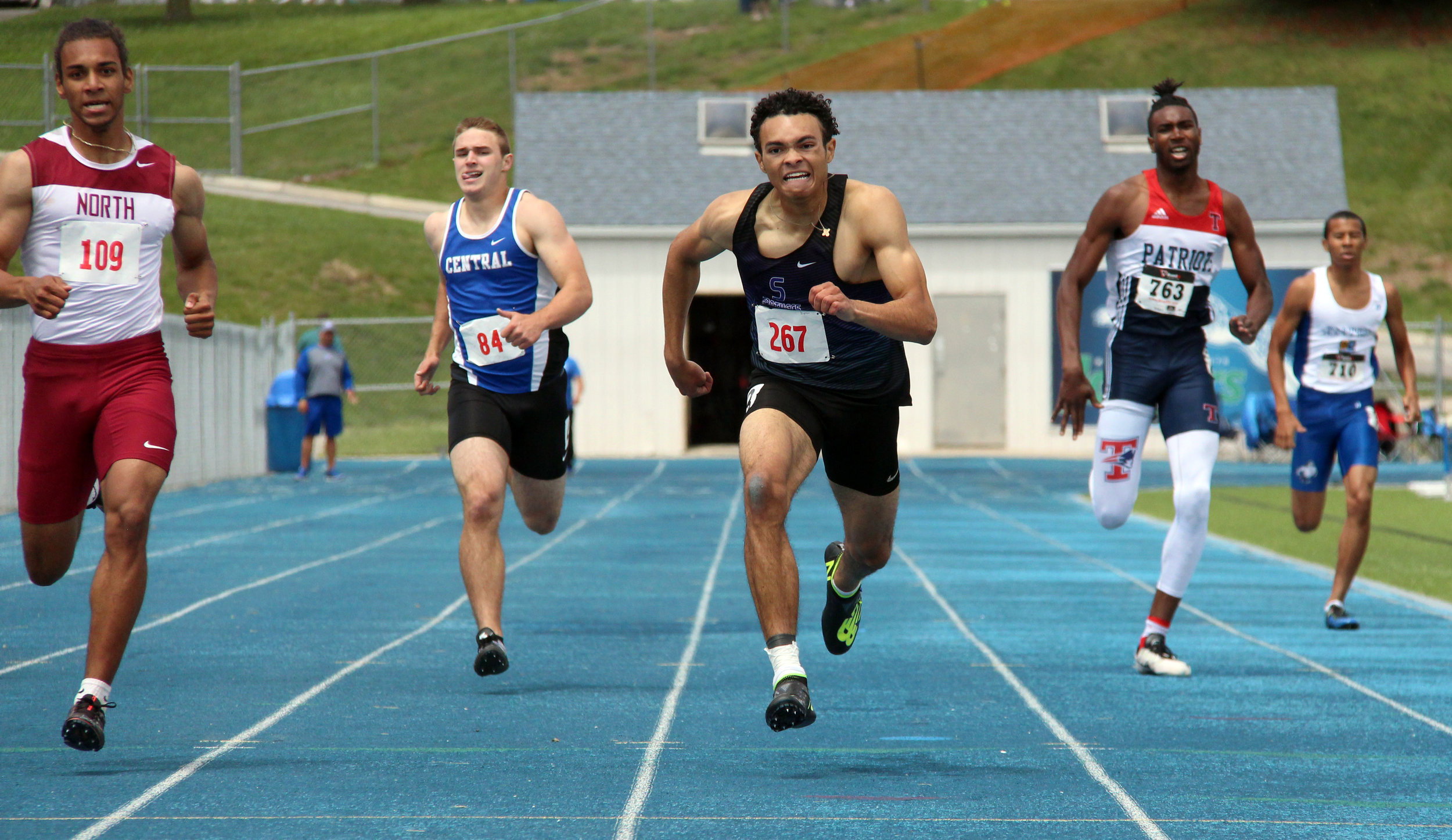 ROSS MARTIN/Citizen photo Park Hill South freshman Chris Dupree pushes to the finish line of the Class 5 Sectional 4 400-meter run Saturday, May 20 at Blue Springs South High School in Blue Springs, Mo.