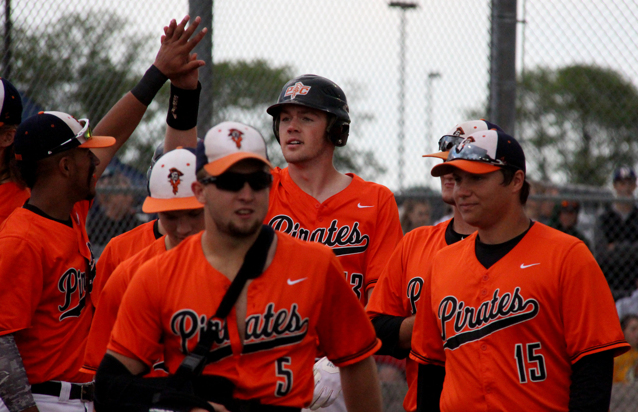 ROSS MARTIN/Citizen photo Platte County senior designated hitter Drew Parmeley, center, celebrates his fifth inning home run during a 9-1 win over Liberty North in a Class 5 sectional Tuesday, May 23 at Liberty North High School in Liberty, Mo.