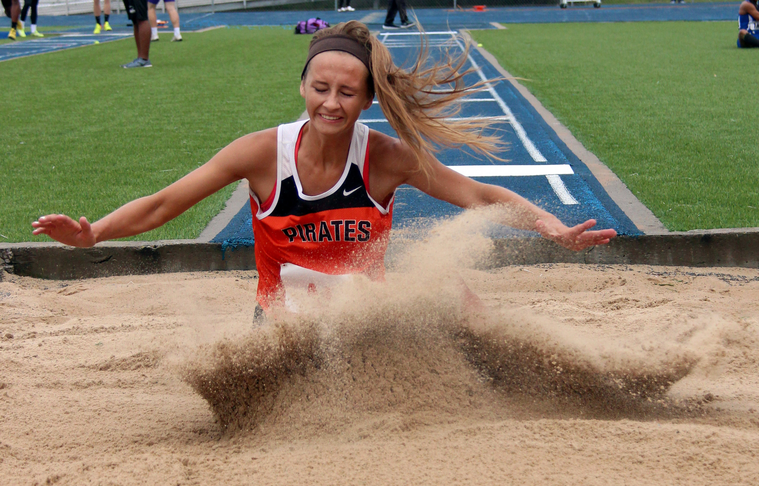 ROSS MARTIN/Citizen photo Platte County senior Tori Farr hits the sand on a long jump attempt in the Class 4 Sectional 4 meet Saturday, May 20 at Blue Springs South High School in Blue Springs, Mo.