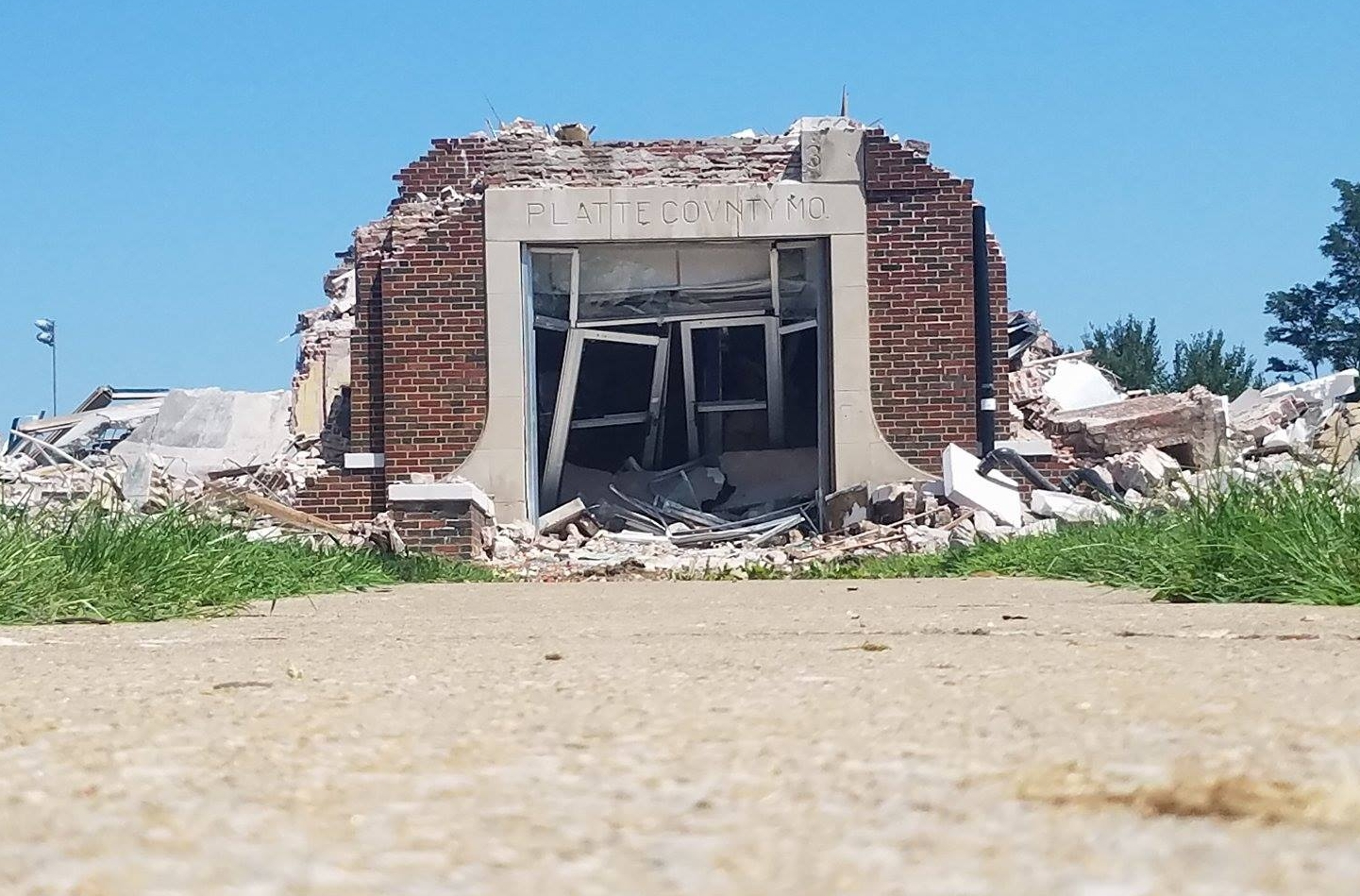 """BREANNA L. CHEADLE/Special to The Citizen Demolition of the 1930 section of the North Platte Junior High/High School campus began Monday, July 24 as crews took down most of the structure except for the main entrance, pictured here. Workers were waiting to remove the """"Platte County, MO"""" stone before finishing the demolition portion of the project."""
