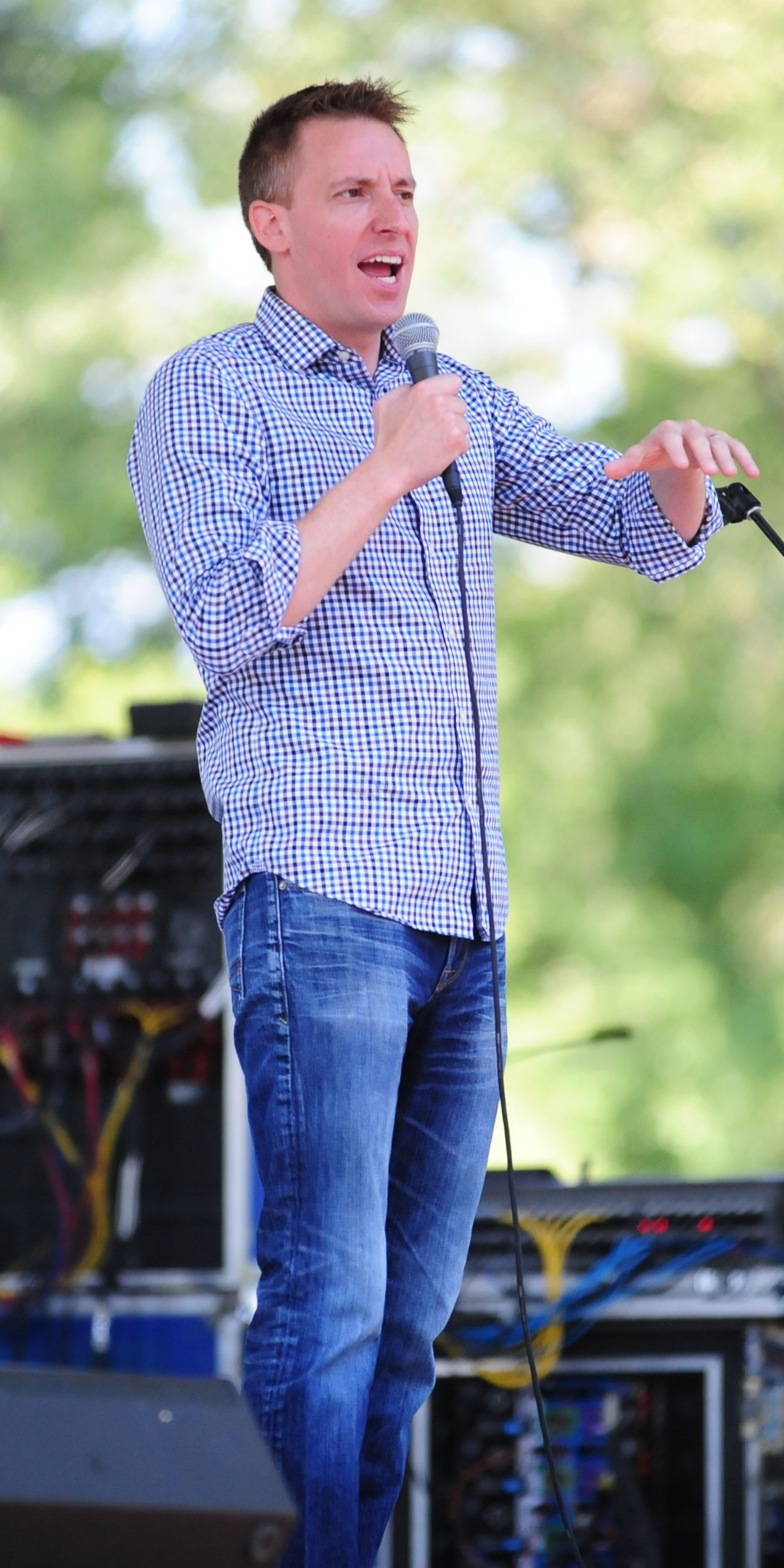 """NICK INGRAM/Citizen photo Jason Kander, former Missouri secretary of state, speaks on voting rights during the """"In for 10"""" festival presented by Northland Progress on Saturday, Aug. 26 at English Landing Park in Parkville, Mo."""