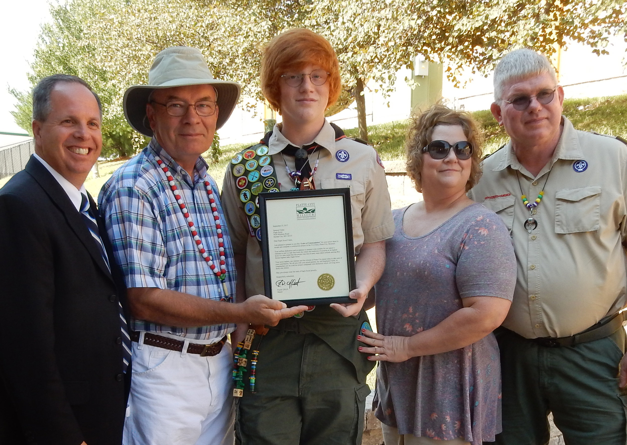 Contributed photo Spencer Fisher received his Eagle Scout merit badge for helping contstruct a patio and sitting area at the VA Clinic in Platte City. On Saturday, Sept. 23, Fisher received a letter of commendation from Platte City mayor Frank Offutt during a small dedication ceremony. Pictured here, from left, are VA director Rudy Klopher, Offutt, Fisher and his parents Stephanie Fisher and Jay Fisher.