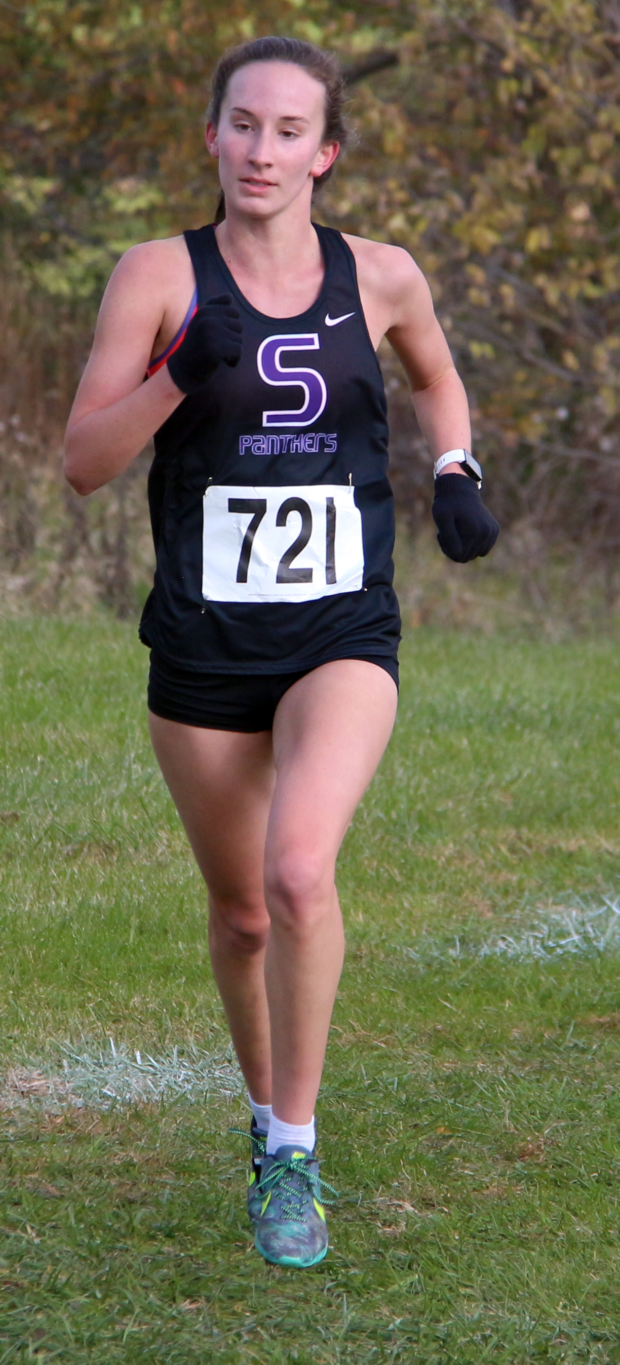ROSS MARTIN/Citizen photo Park Hill South senior Marti Heit heads toward the finish line of the Class 4 Sectional 4 race Saturday, Oct. 28 at Jesse James Fairgrounds in Kearney, Mo.