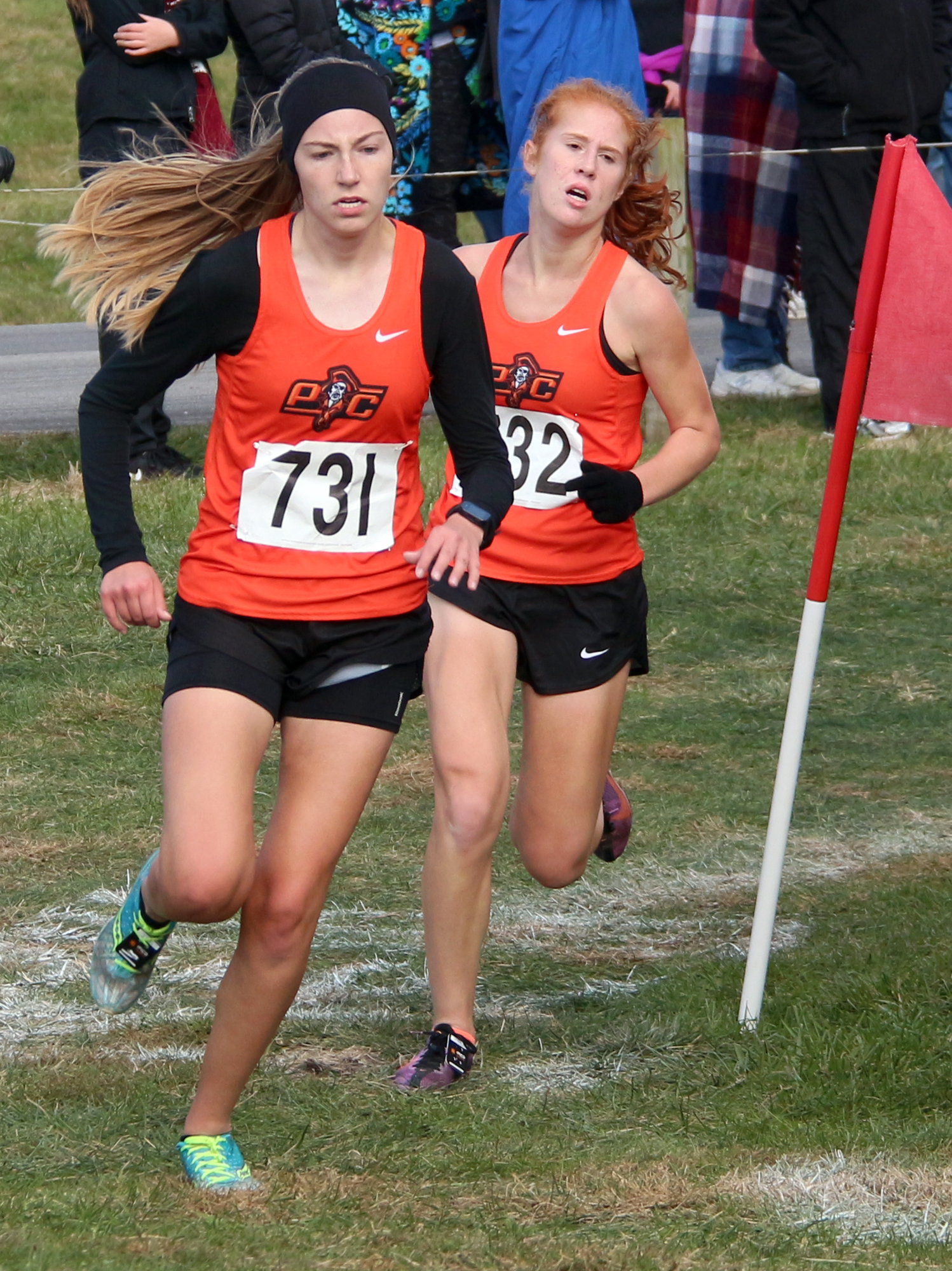 ROSS MARTIN/Citizen photo Platte County seniors Lauren Johnson, left, and Erin Straubel make the turn at the 2-mile mark of the race Saturday, Oct. 28.