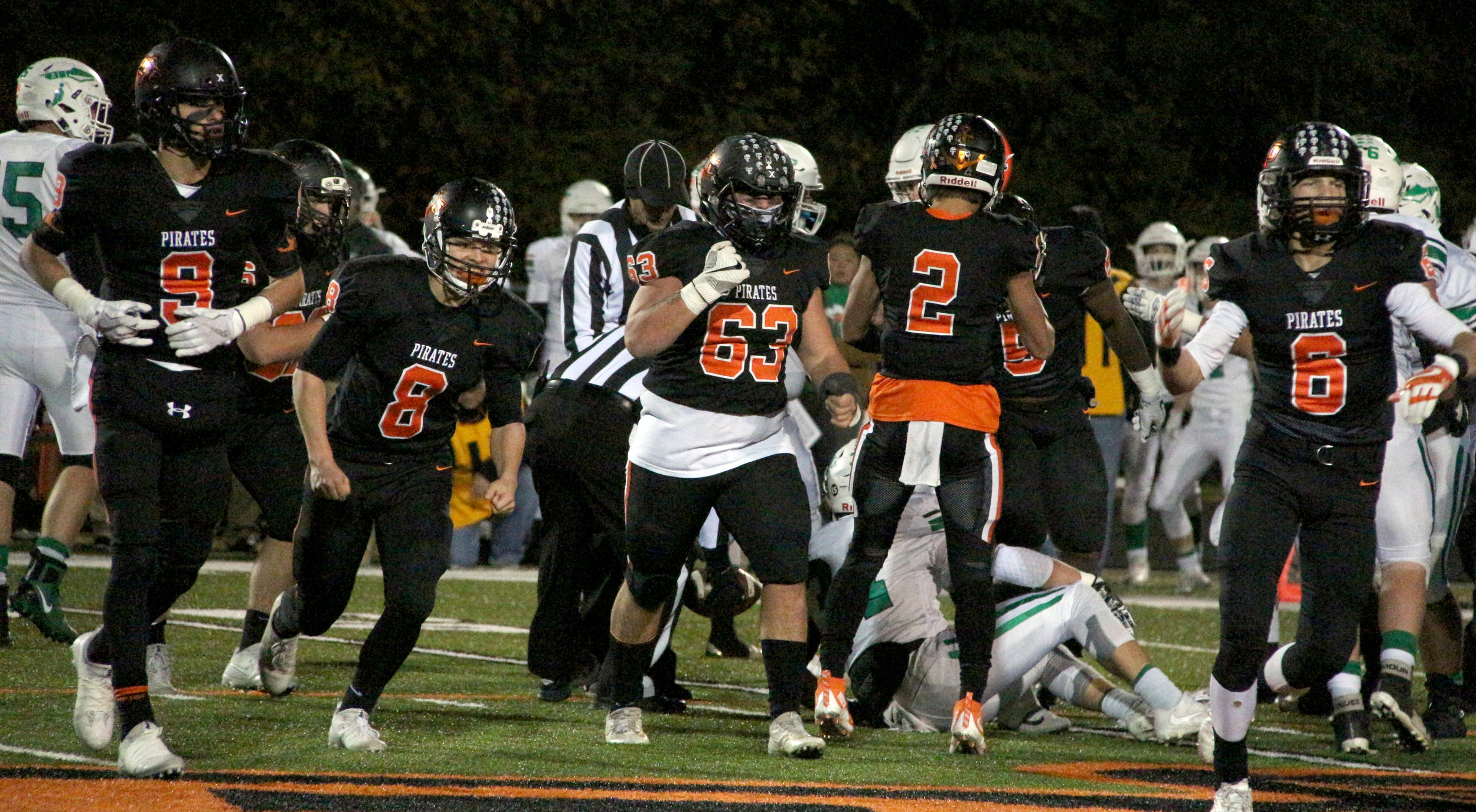 ROSS MARTIN/Citizen photo Platte County defenders Dylan Gilbert (9), Hunter Tongate (8), Sage Smart (63) and Nolan Saale (6) celebrate a stop in the second half of a Class 4 District 8 semifinal win over Smithville on Friday, Oct. 27 at Pirate Stadium. Platte County won 42-13.