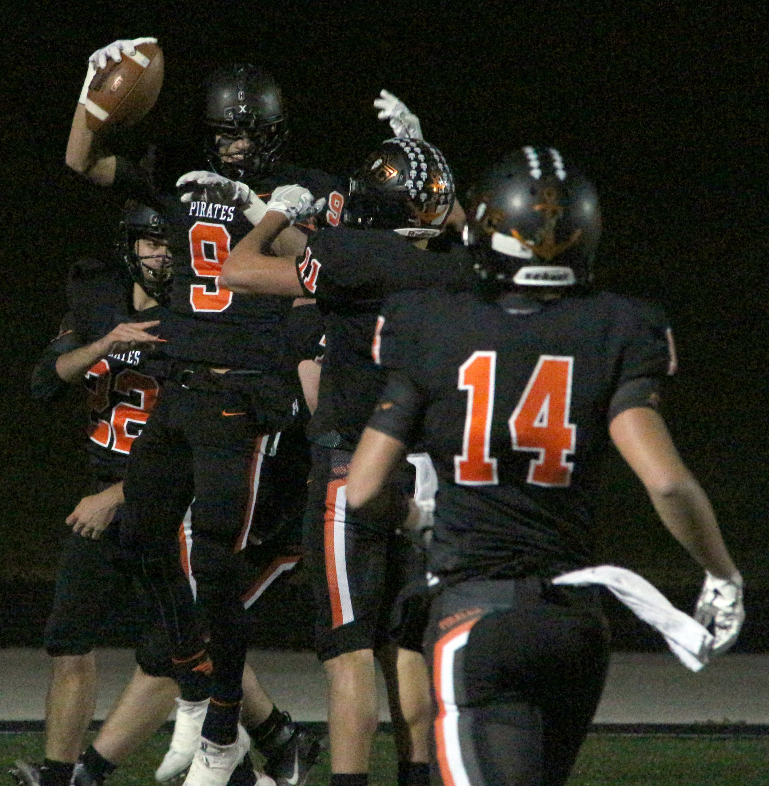 ROSS MARTIN/Citizen photo Platte County junior Dylan Gilbert (9) celebrates one of his two first half touchdowns in a Class 4 District 8 semifinal win over Smithville on Friday, Oct. 27 at Pirate Stadium.