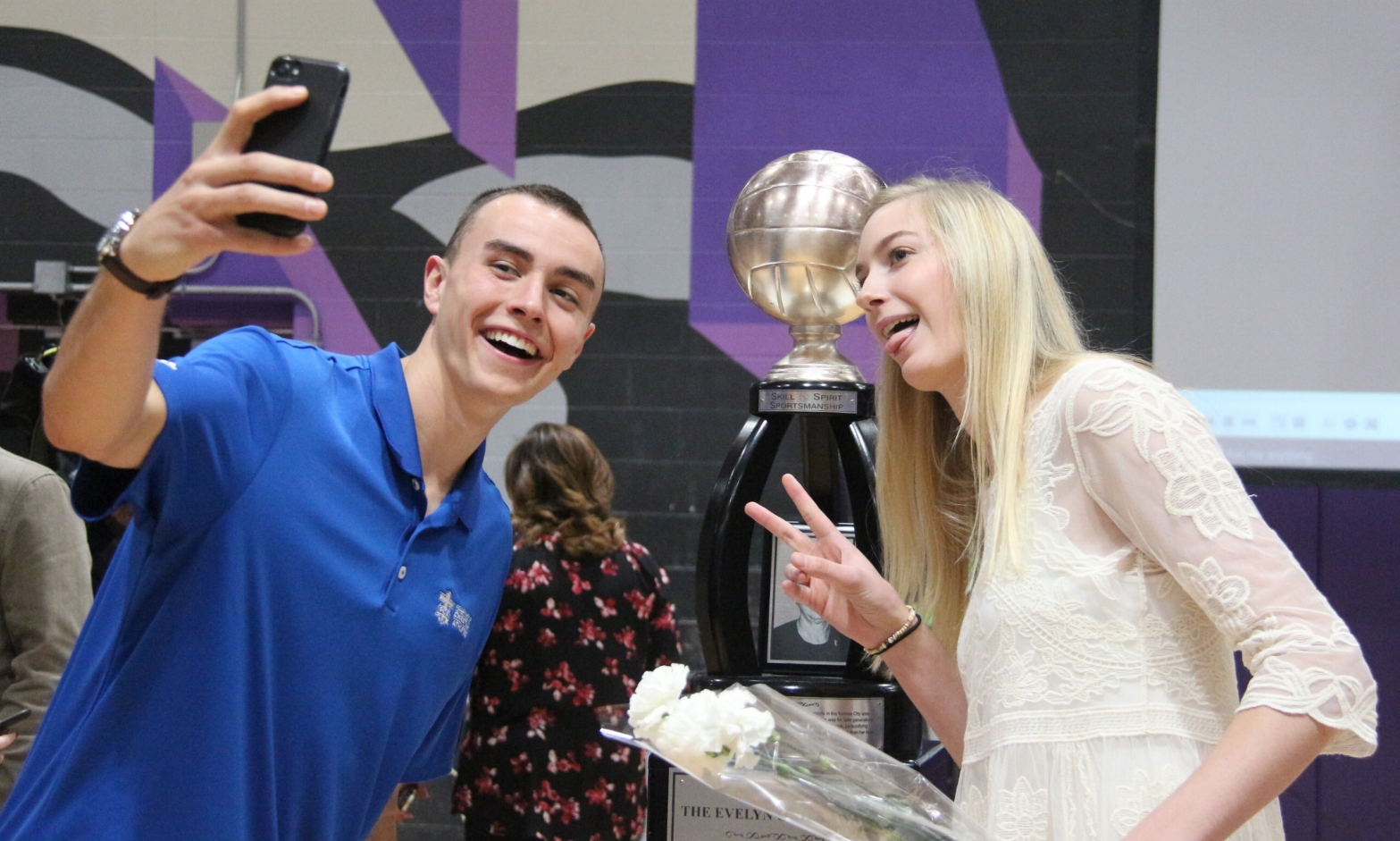 ROSS MARTIN/Citizen photo Park Hill South senior Annika Welty, right, poses for a selfie with older brother Hudson Welty after she won the Evelyn Gates Award, given to the top high school volleyball player in the Kansas City metro area, at a ceremony held Thursday, Nov. 16 at Park Hill South High School in Riverside, Mo.