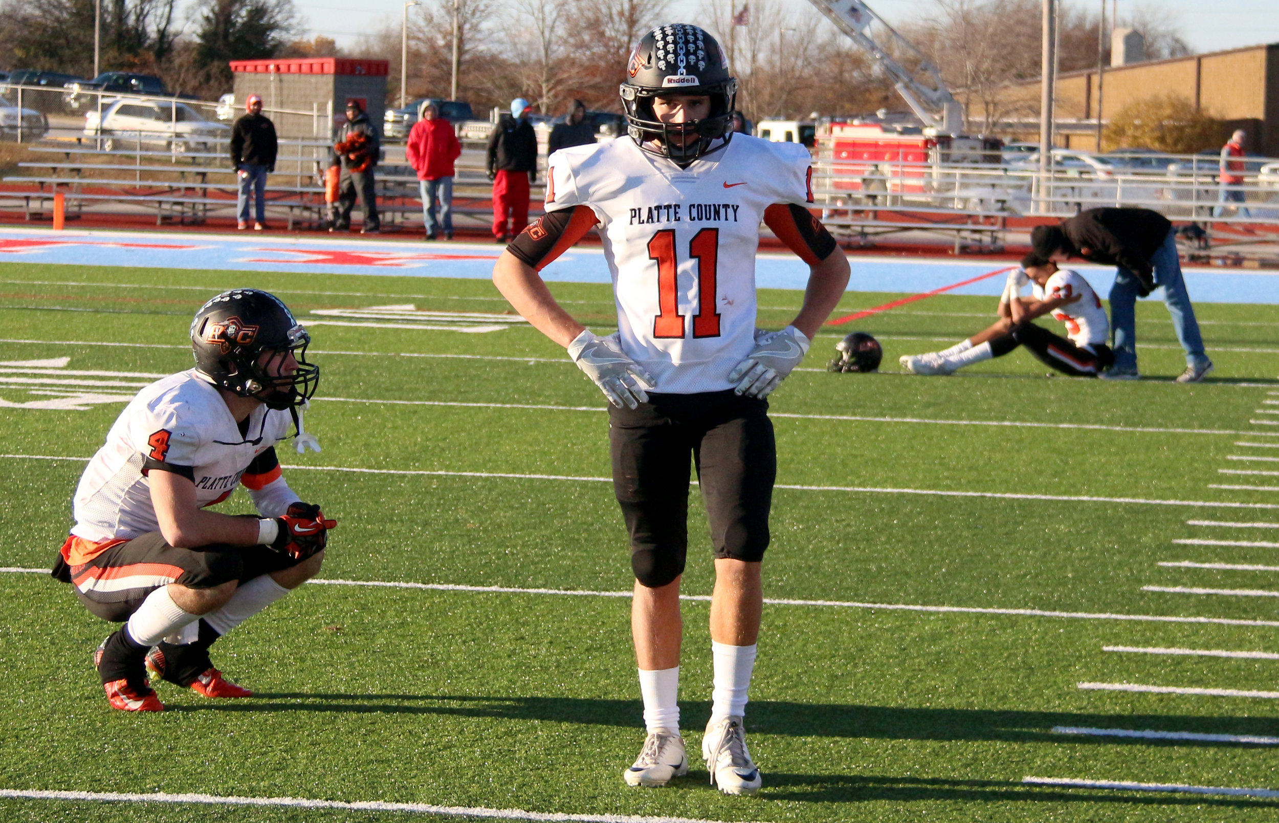 ROSS MARTIN/Citizen photo ABOVE: Platte County seniors Gavin Hardman (4), Devin Richardson (11) and John Watts (right) react after the final play of a 21-18 loss to Webb City in a Class 4 semifinal Saturday, Nov. 18 at Cardinal Stadium in Webb City, Mo.