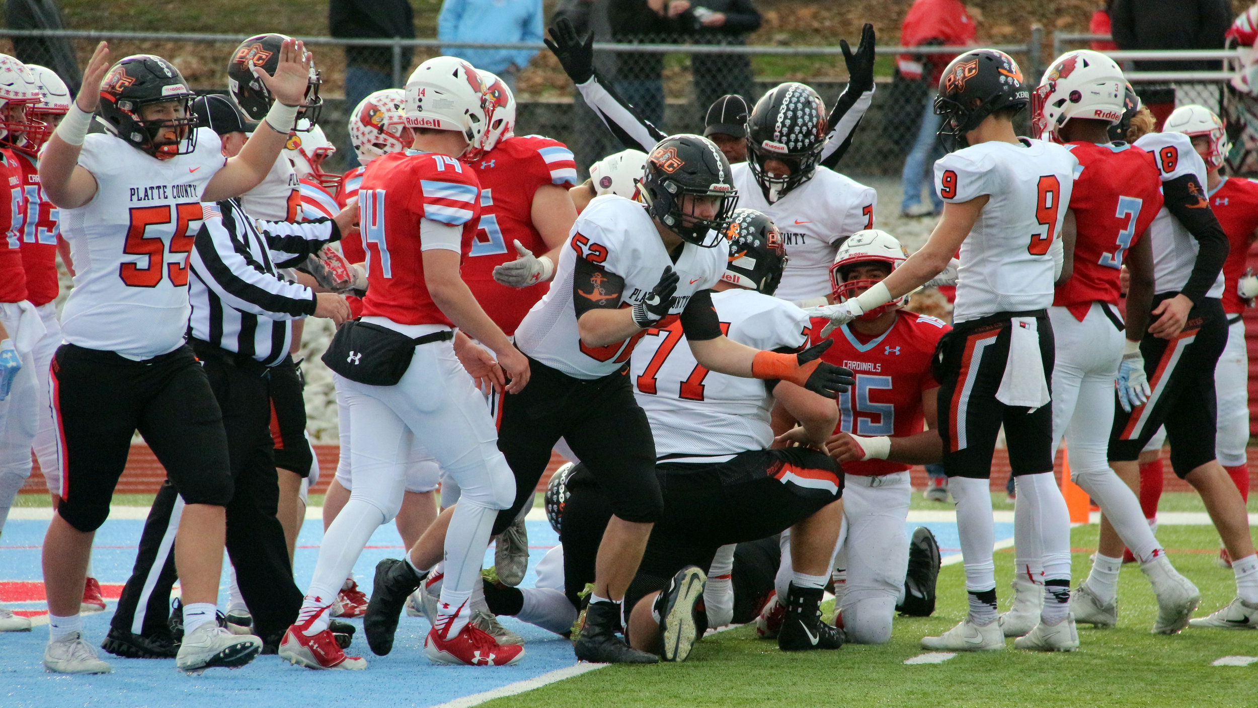 ROSS MARTIN/Citizen photo Platte County players, including offensive linemen Matt Blaha (55) and Peyton Stoner (52). celebrate a touchdown during a Class 4 semifinal Saturday, Nov. 18 at Cardinal Stadium in Webb City, Mo.