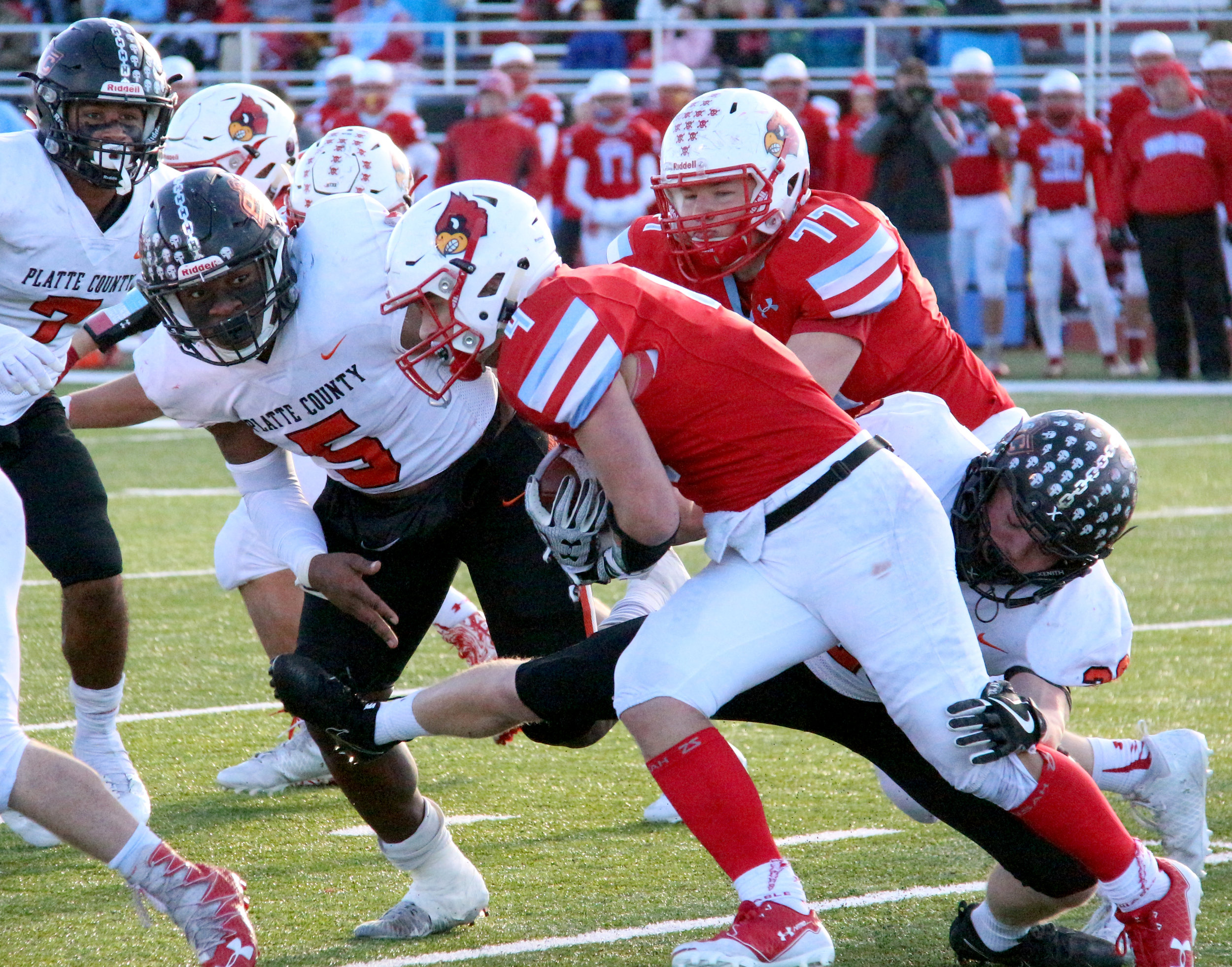 ROSS MARTIN/Citizen photo ABOVE: Platte County seniors Michael Smith (5) and Dakota Schmidt (bottom right) make a tackle in a Class 4 semifinal Saturday, Nov. 18 at Cardinal Stadium in Webb City, Mo.