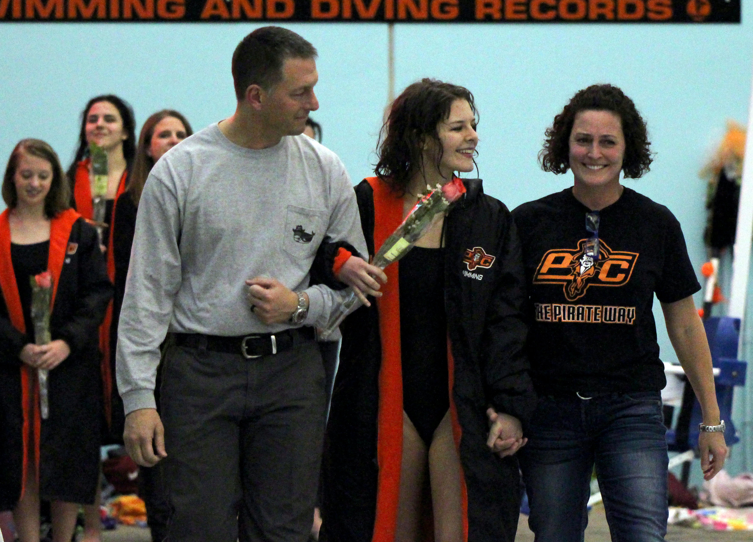 Platte County senior Bailey Newell, center, was joined by her parents Byron and Marcella Newell during senior night for the Pirates on Thusday, Jan. 4 at the Platte County Community Center North in Platte City, Mo.
