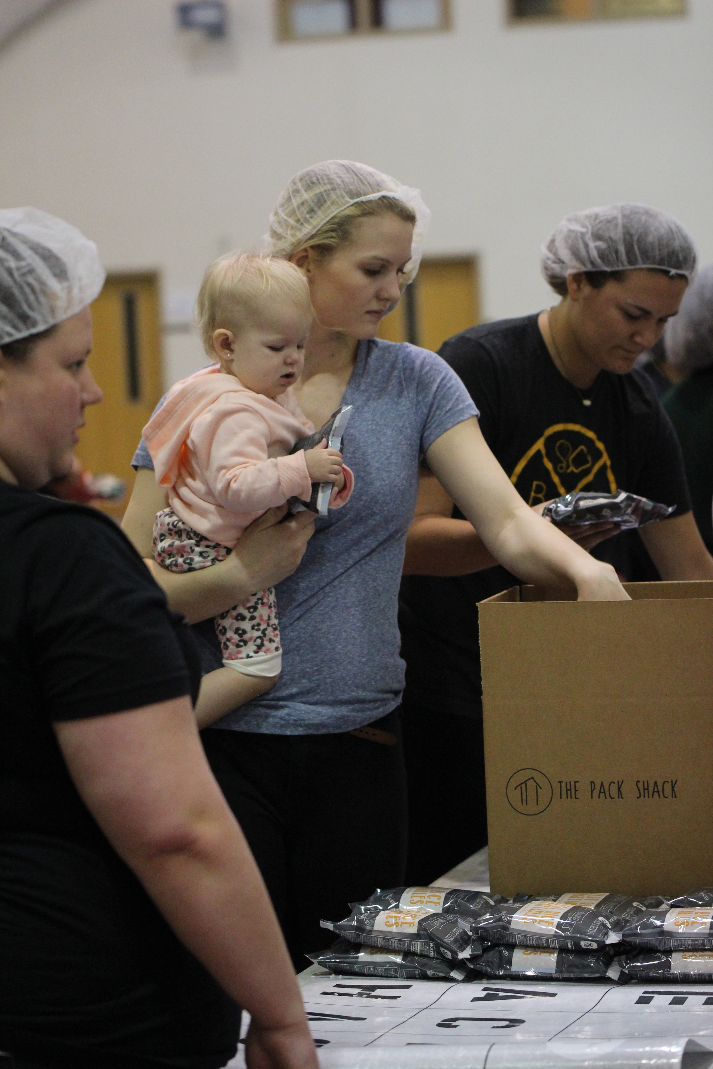 Cody Thorn/Citizen photo Park volleyball player Maren Mair, a Platte County graduate, was one of many volunteers and got a helping hand from her 13-month-old daughter Avi.