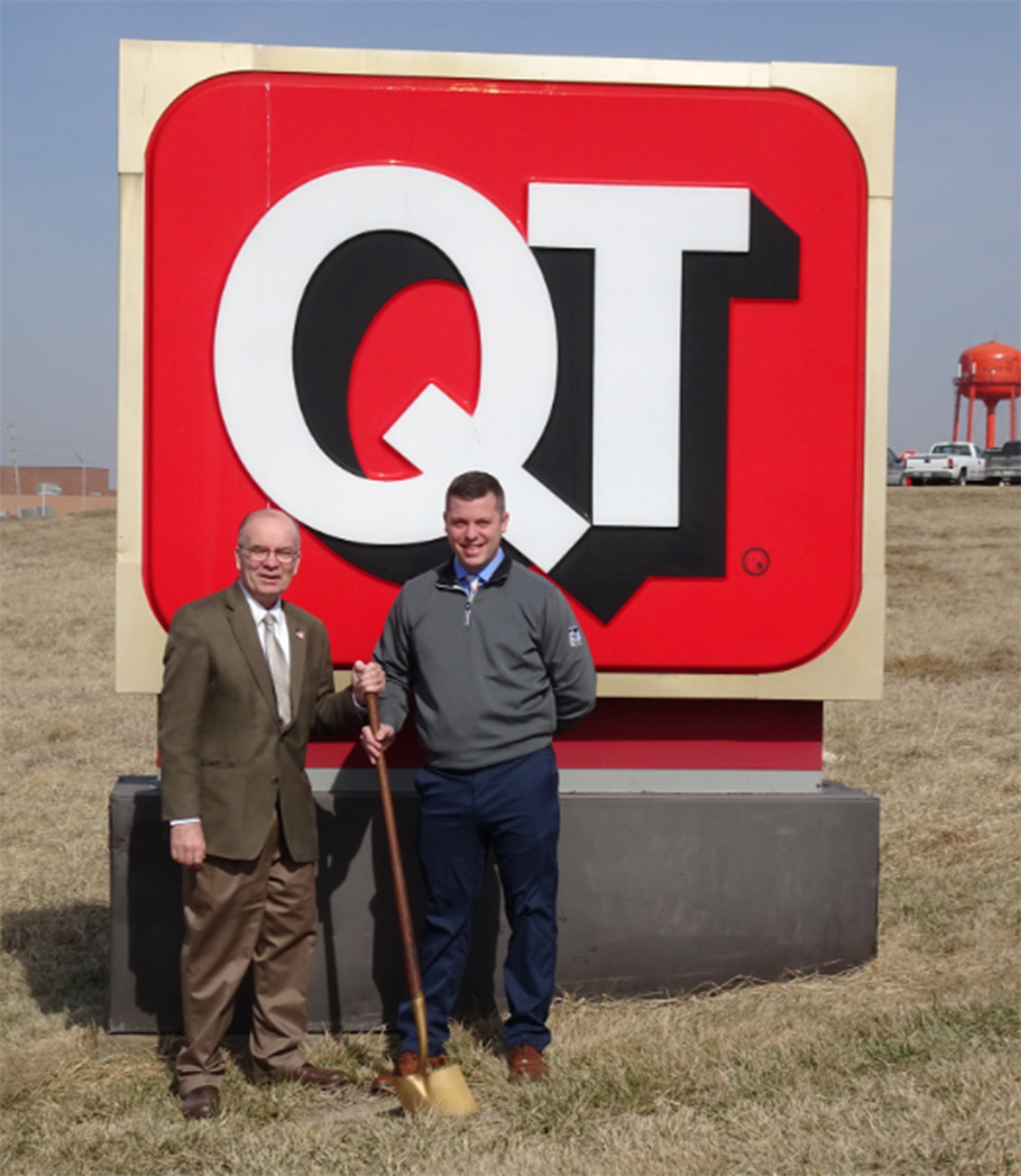 City of Platte City photo Platte City Mayor Frank Offutt, left, and Erik Eckhart, QuikTrip real estate project manager, stand in front of the existing QuikTrip monument sign at Kentucky Avenue and Highway 92.