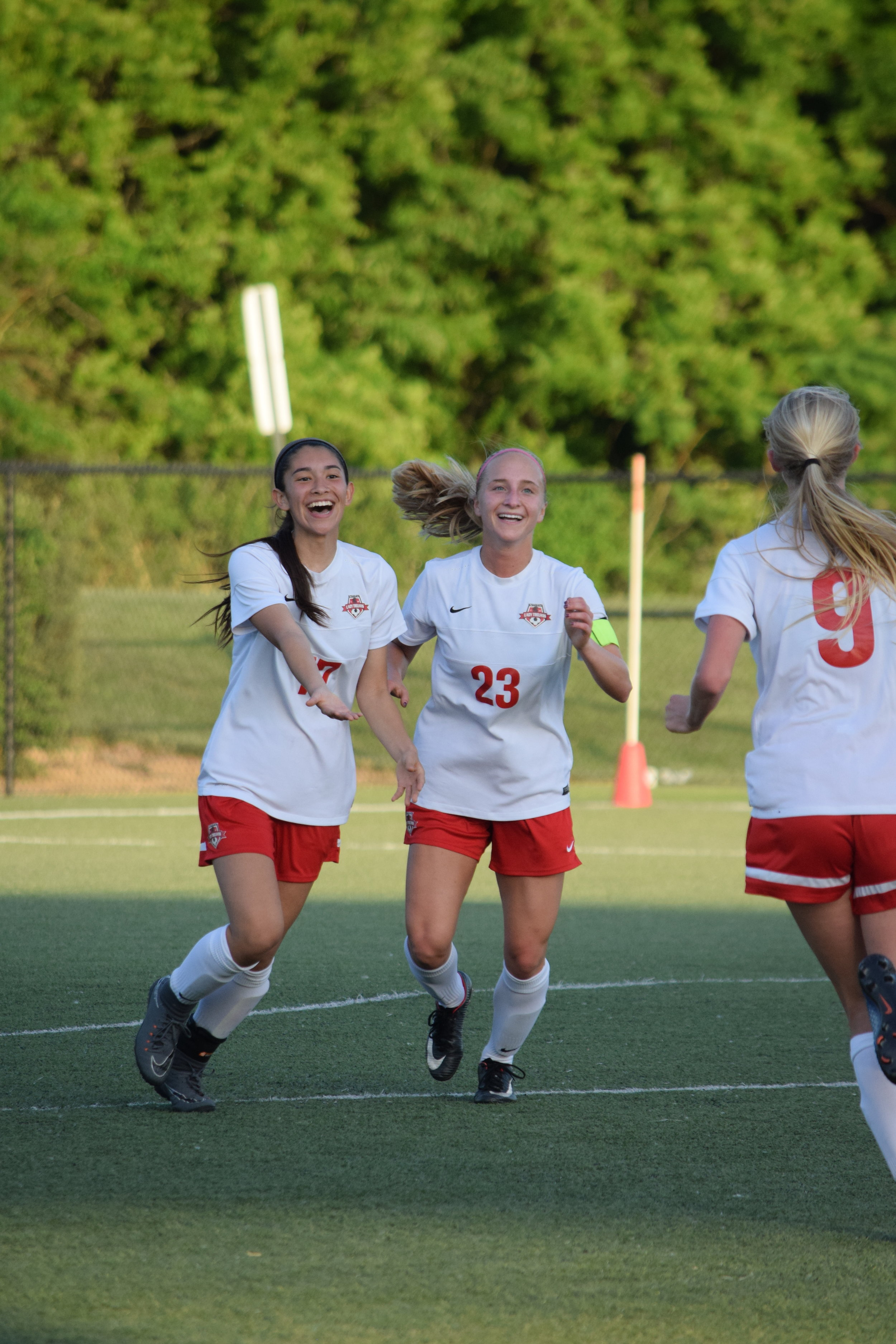 BRYCE MERENESS/Citizen photo Park Hill's Ayana Weissenfluh, left, and Ali Walls, celebrate the first goal of the game on Tuesday, May 22, against Liberty North in the Class 4 playoffs. The Trojans won 3-0 to advance to Saturday's quartefinal round.