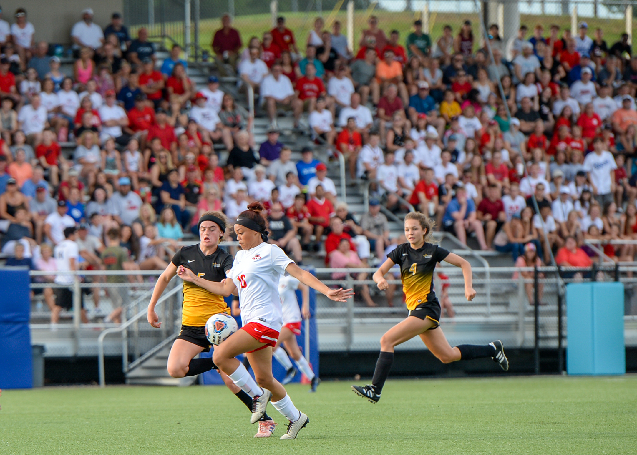 TODD NUGENT/Special to the Citizen Park Hill's Alyssa Ramos, right, battles for possession of the ball in during a Class 4 quarterfinal game held Saturday, May 26 at the Park Hill District Soccer Complex in Riverside, Mo.
