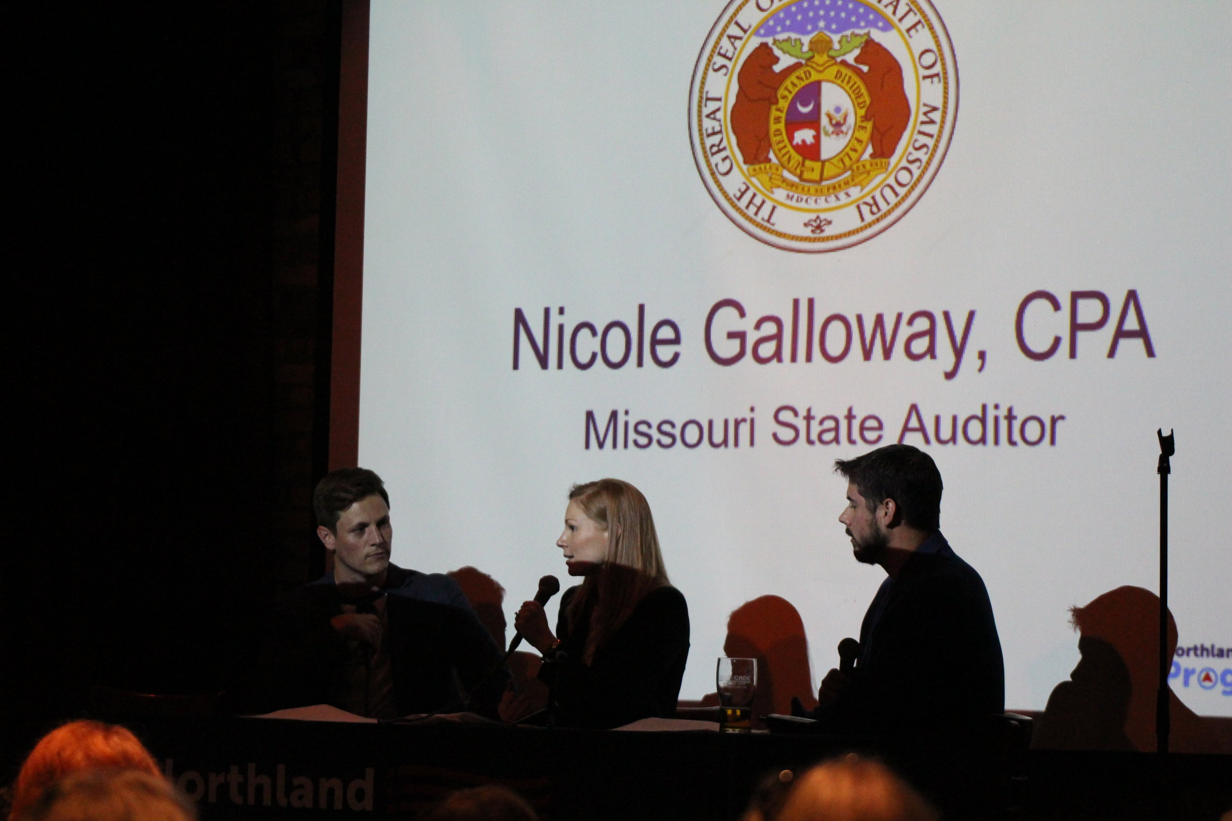 CODY THORN/Citizen editor Missouri State Auditor Nicole Galloway, center, talks during a Northland Progress event on Tuesday, June 5 at the Kansas City Improv at Zona Rosa. She is sitting between Northland Progress president Blake Green (left) and treasurer Mike Amash.