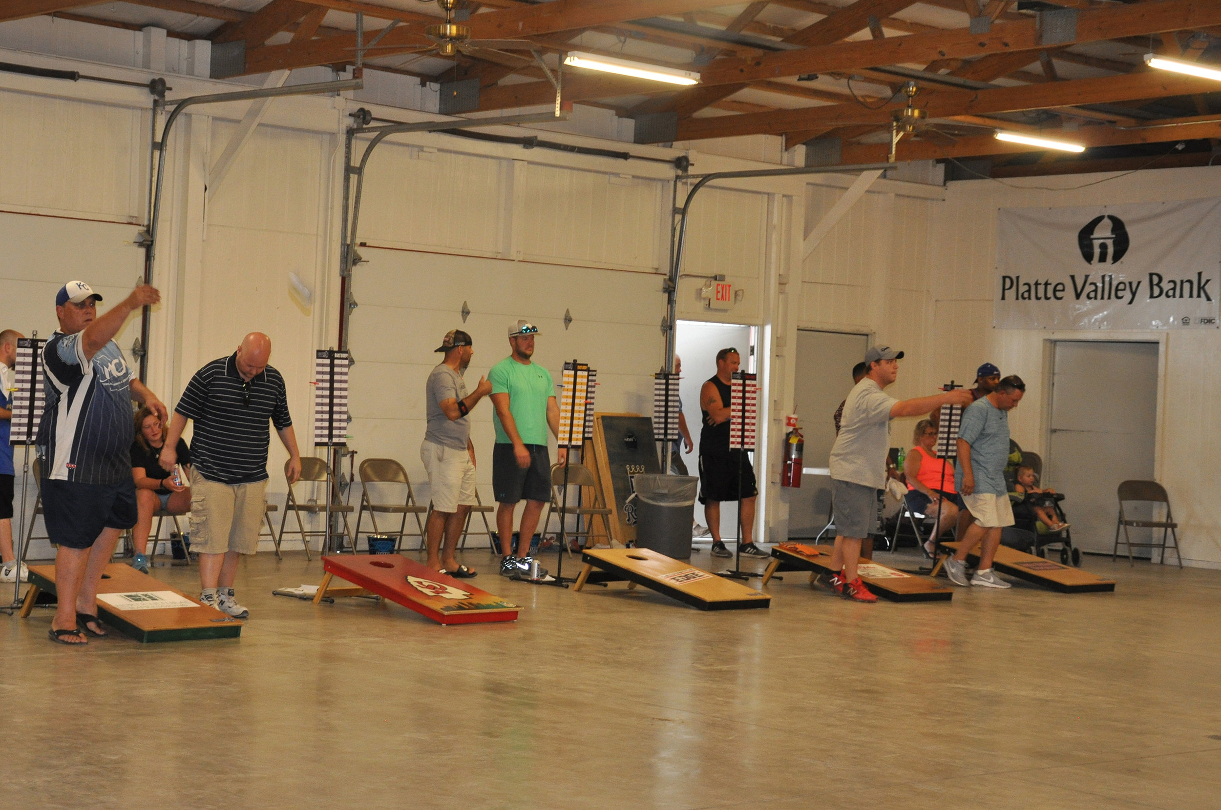 CYNTHIA CLARK/Special to the Citizen Mark Isley, far left, helped run the first-ever Platte County Fair Cornhole Tournament and competed in the event as well on Saturday, July 21, in the Platte Purchase Building in Tracy, Mo.