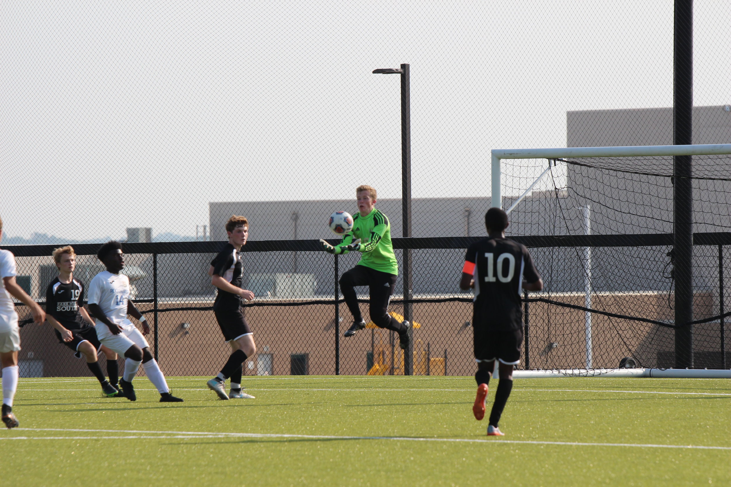 CODY THORN/Citizen photo Park Hill South goalkeeper Cade Meeks jumps in the air to make a save against Rockhurst on Friday, Aug. 24 at the Park Hill School District Soccer Complex in Riverside, Mo. Park Hill South won the game, 1-0.