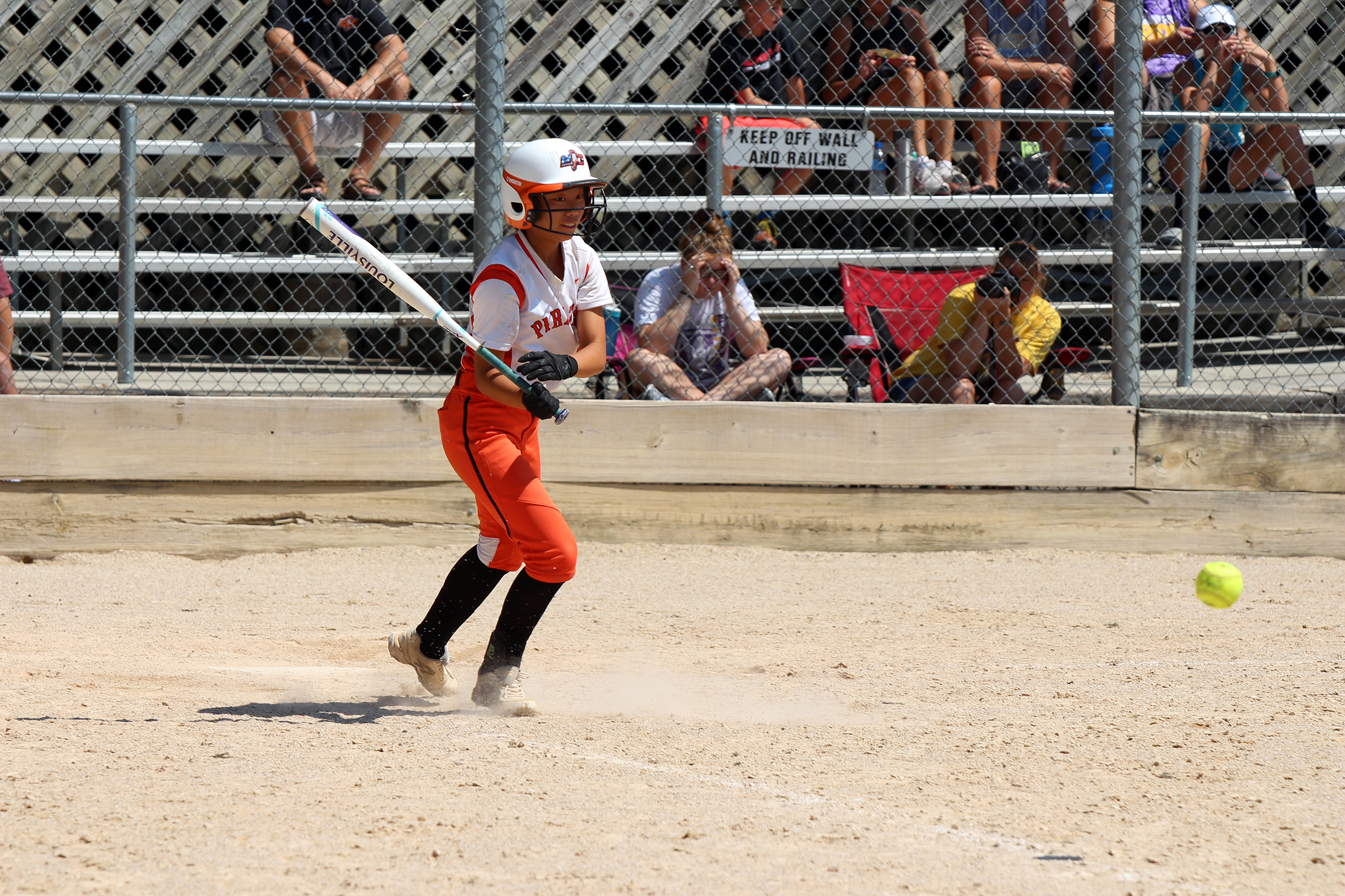 Platte County's Stephanie Carroll hits a grounder against Pleasant Hill on Saturday, Aug. 25 at the Greater Kansas City Softball Tournament in Independence, Mo.