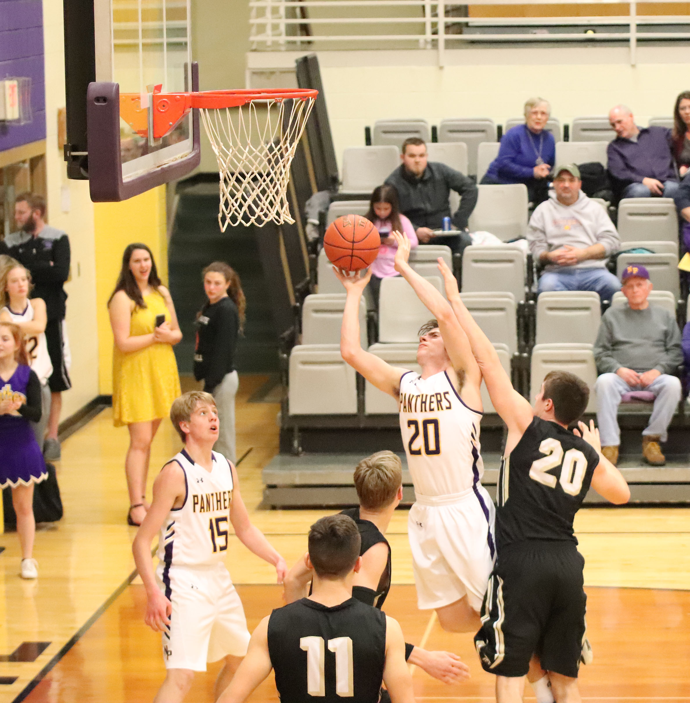 CODY THORN/Citizen photo  North Platte's Ty French, shooting, draws a foul by Lathrop's Colton Nichols during the second half of a KCI Conference game on Thursday, Jan. 17 in Dearborn, Mo.