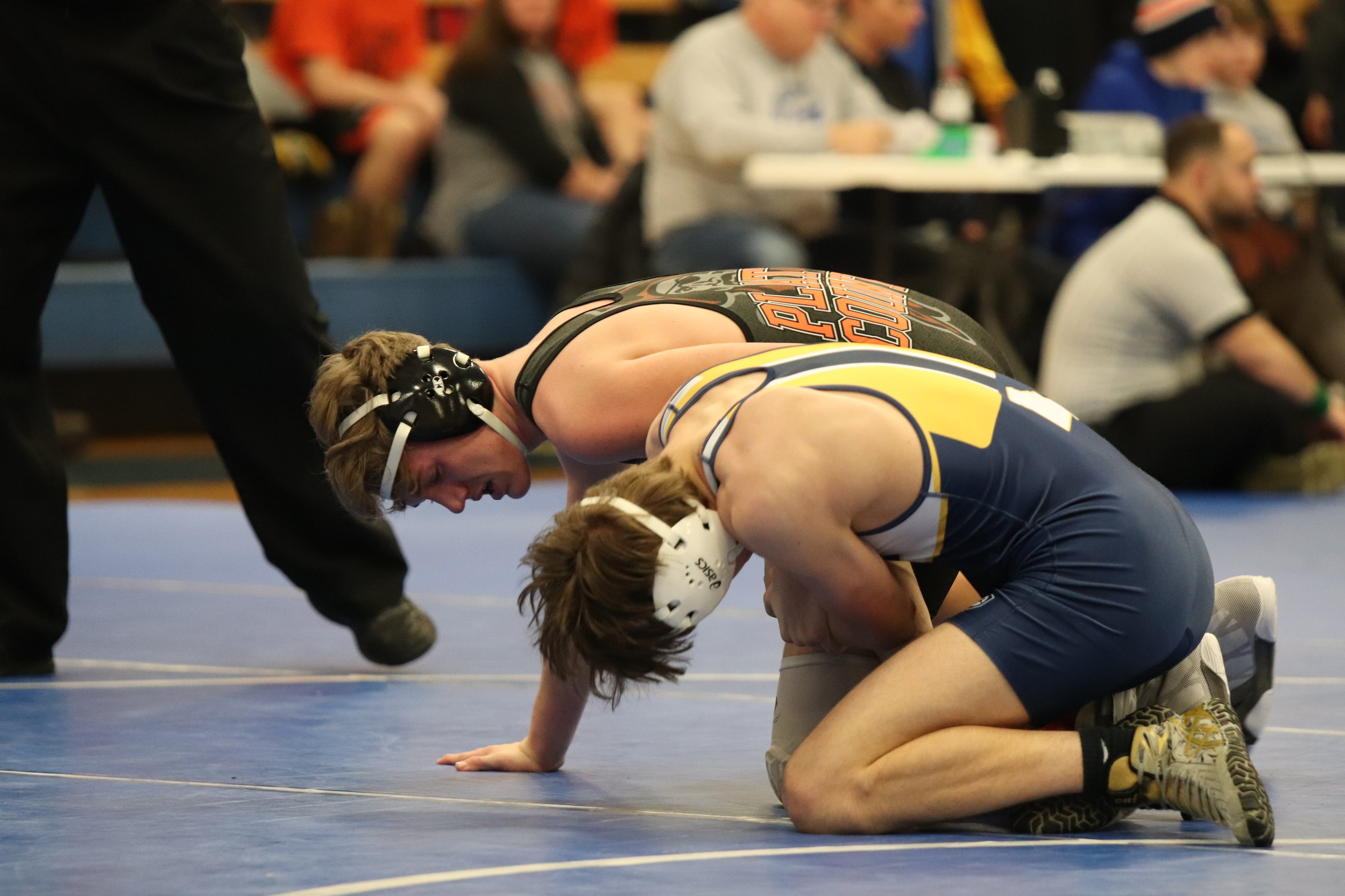 Platte County's A.J. Bingham, left, battles Liberty North' JV's Joseph Cherco in a match on Saturday, Jan. 26 at the West Platte Invitational in Weston, Mo.