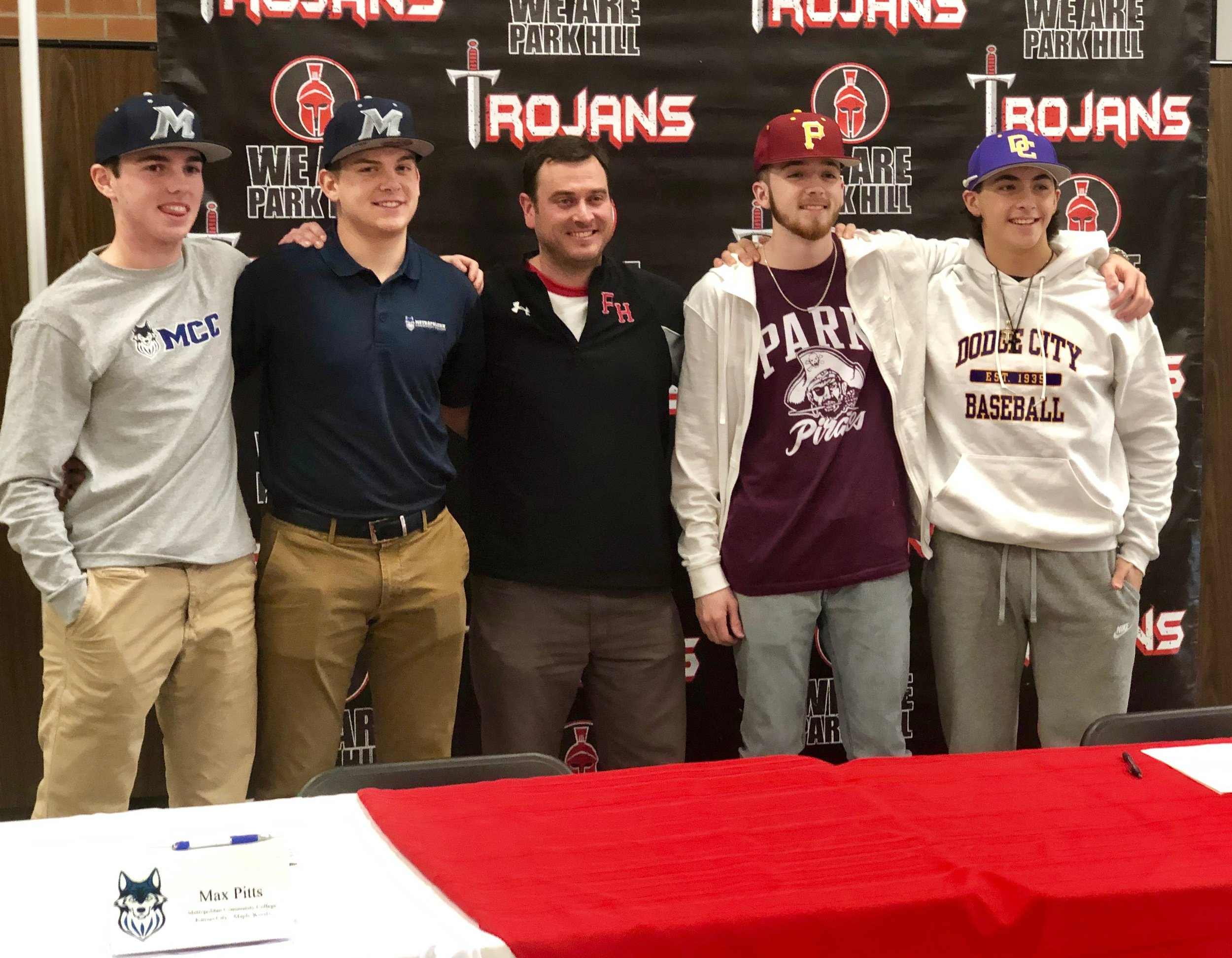 Submitted photo  Four Park Hill baseball players signed scholarships on Monday, Jan. 28. Pictured from left, Hunter Atkinson (Maple Woods), Max Pitts (Maple Woods), Park Hill baseball coach Blaine Lewis, Cameron Knight (Park) and Joe Daneff (Dodge City Community College).