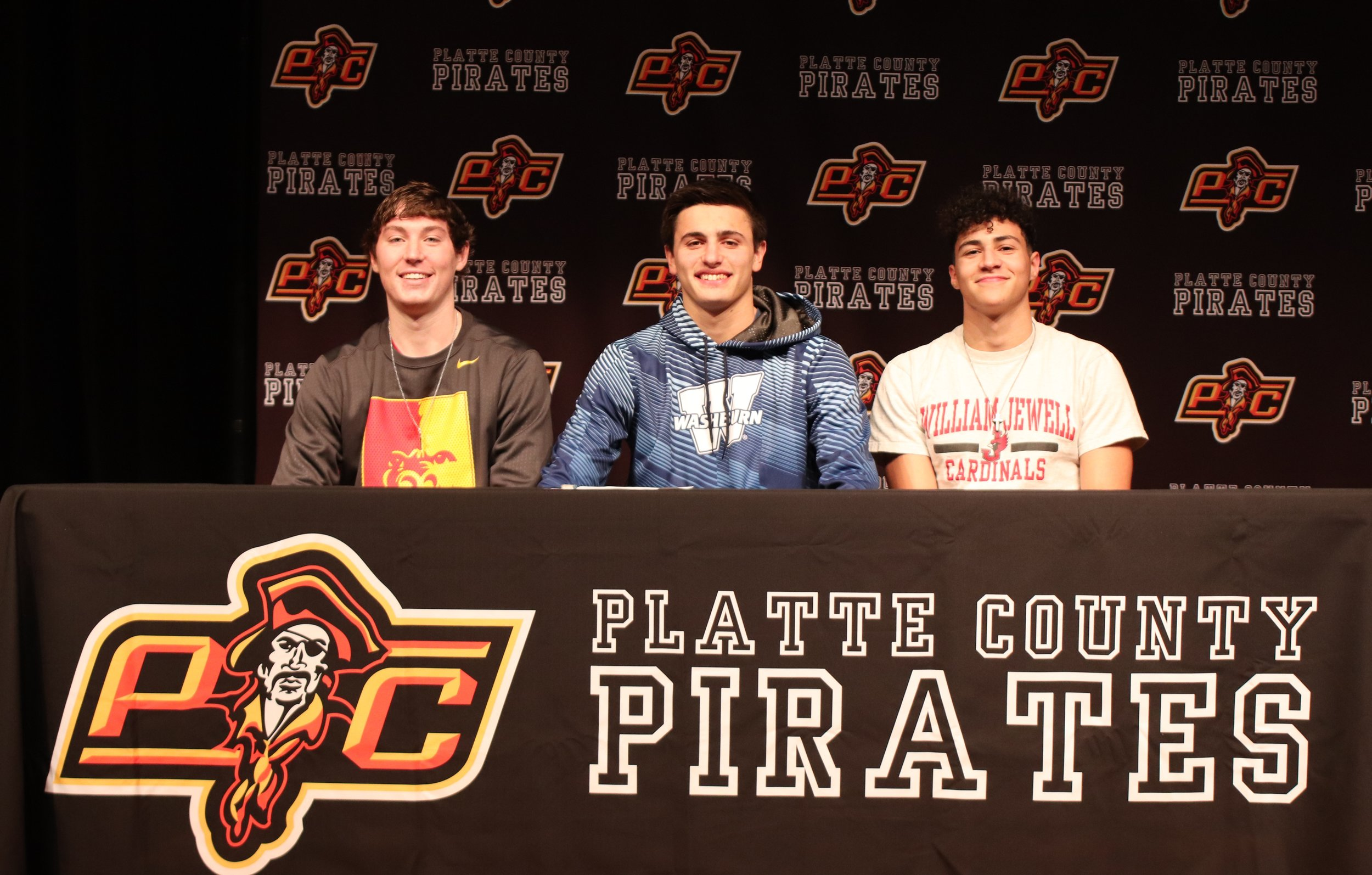 ROSS MARTIN/Special to the Citizen  Platte County athletes Ethan Esdohr (baseball), Dylan Gilbert (football) and Brice Bertram (football) all signed scholarships on Thursday, Feb. 7.