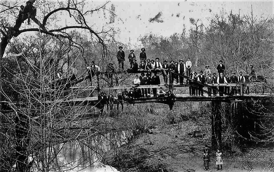 Contributed photo This undated photo shows the bridge - along with many of the residents of the town — not long after its construction. Trustees are searching for other historical information and artifacts to document Iatan's history.
