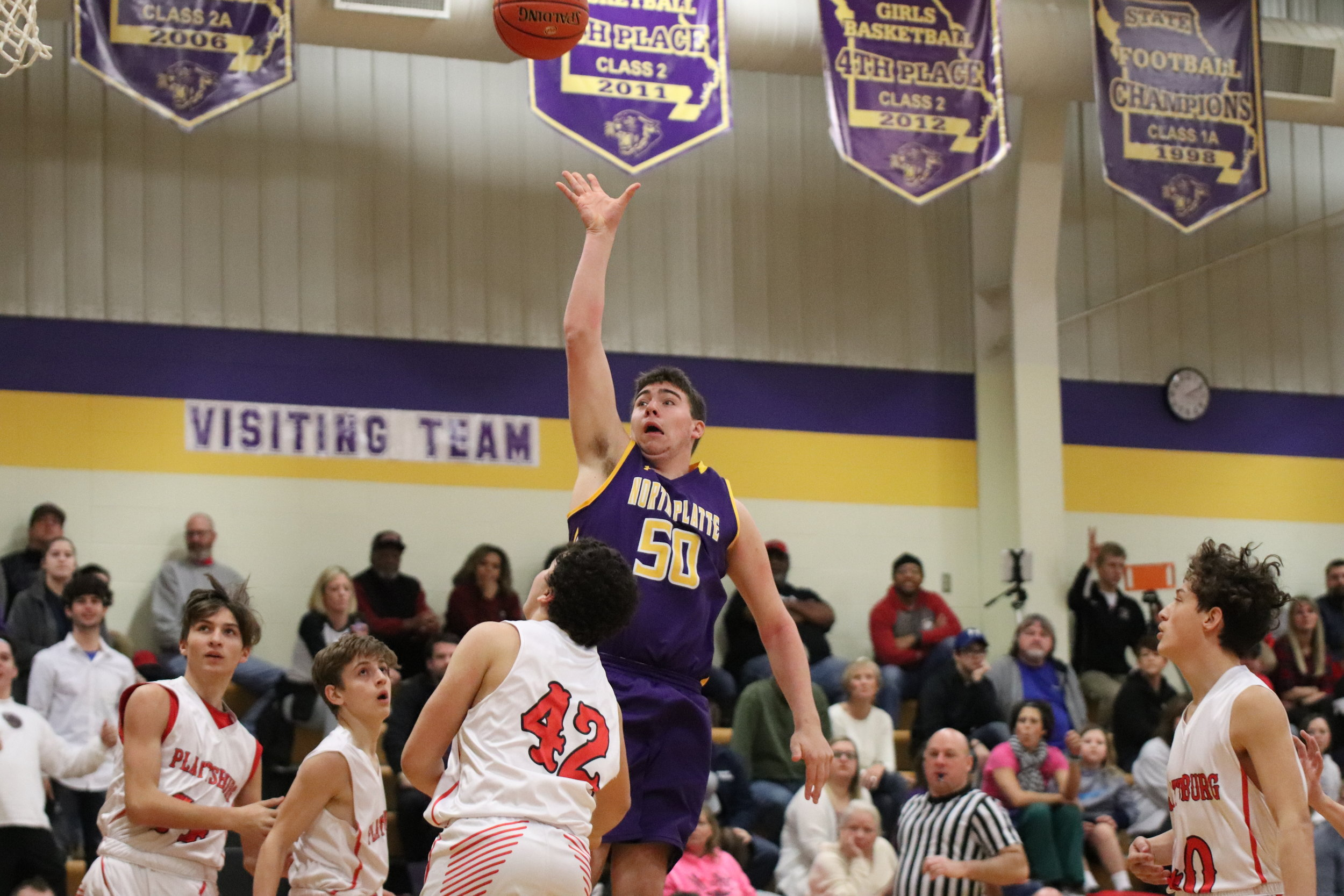CODY THORN/Citizen photo  North Platte junior Cam Leupold shoots a jumper over Plattsburg's Cordell Fish during the Class 2 District 15 championship game on Saturday, Feb. 23 at North Platte High School in Dearborn.