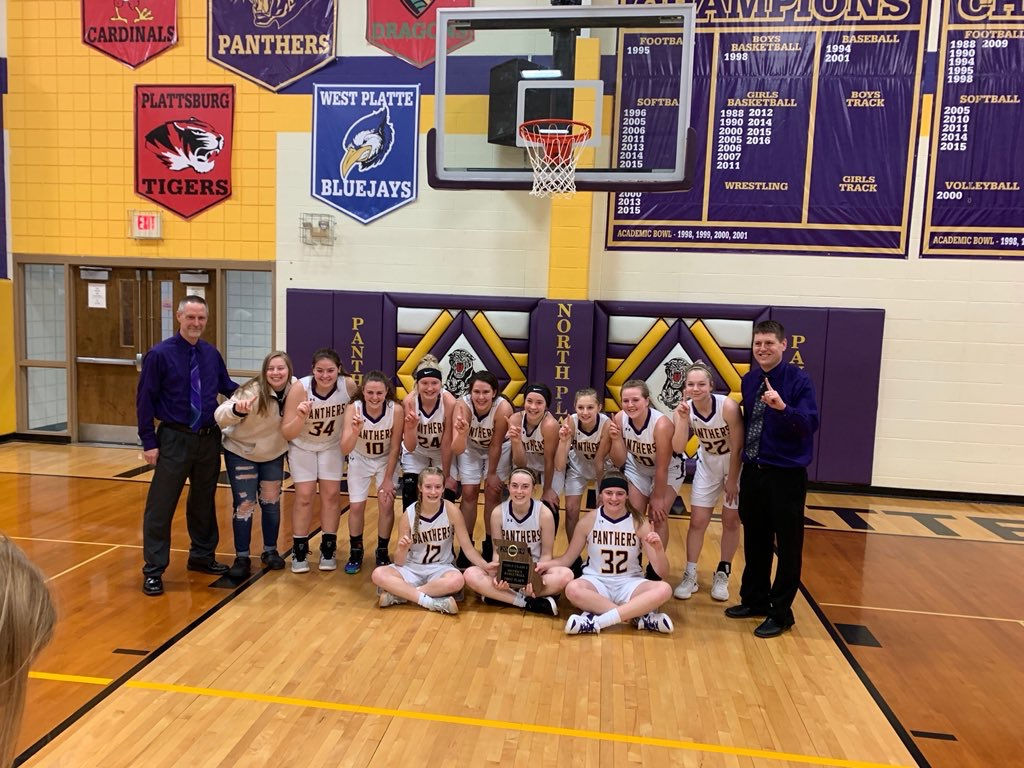 Submitted photo  The North Platte girls team celebrate winning a district title with a 62-34 win against Cass-Midway on Saturday, Feb. 23 in Dearborn.