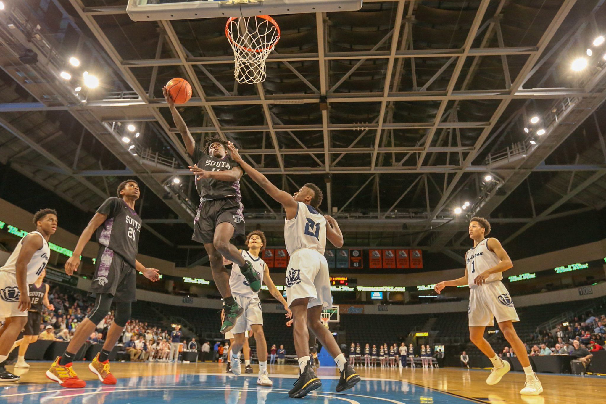 Ed Maygar/Special to the Citizen Park Hill South's Lamel Robinson, center, goes up for a layup during a Class 5 sectional game on Wednesday, March 6 at the Silverstein Eye Centers Arena.