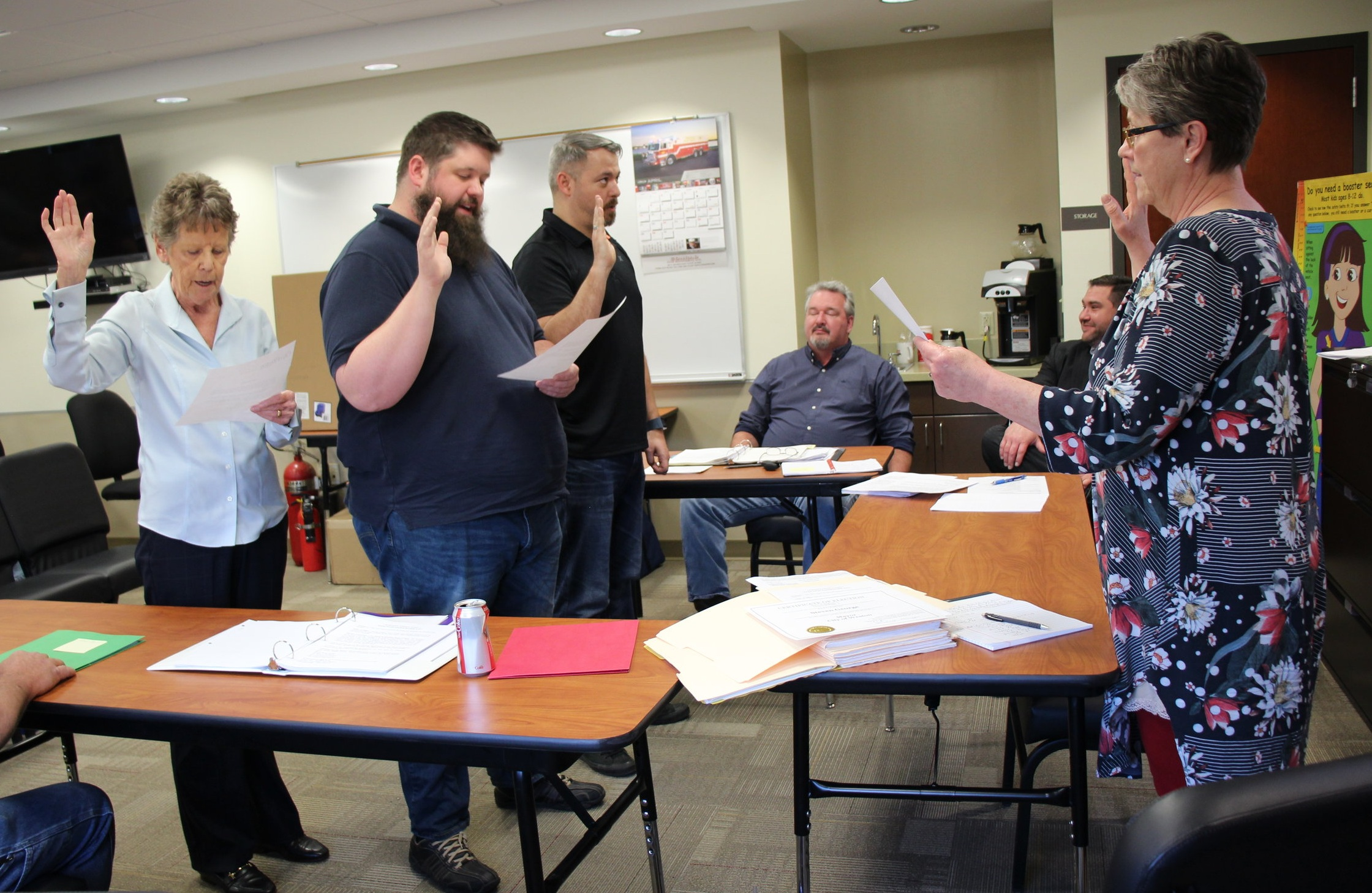 JEANETTE FAUBION/Citizen photo City clerk Kim Kirby swore in new mayor Steven George, new alderman Michael Goentzel and returning alderman Joyce Priddy at the Monday, April 8 board of aldermen meeting, held at the West Platte Fire Station due to flooding last month around city hall. Priddy was elected president of the board.