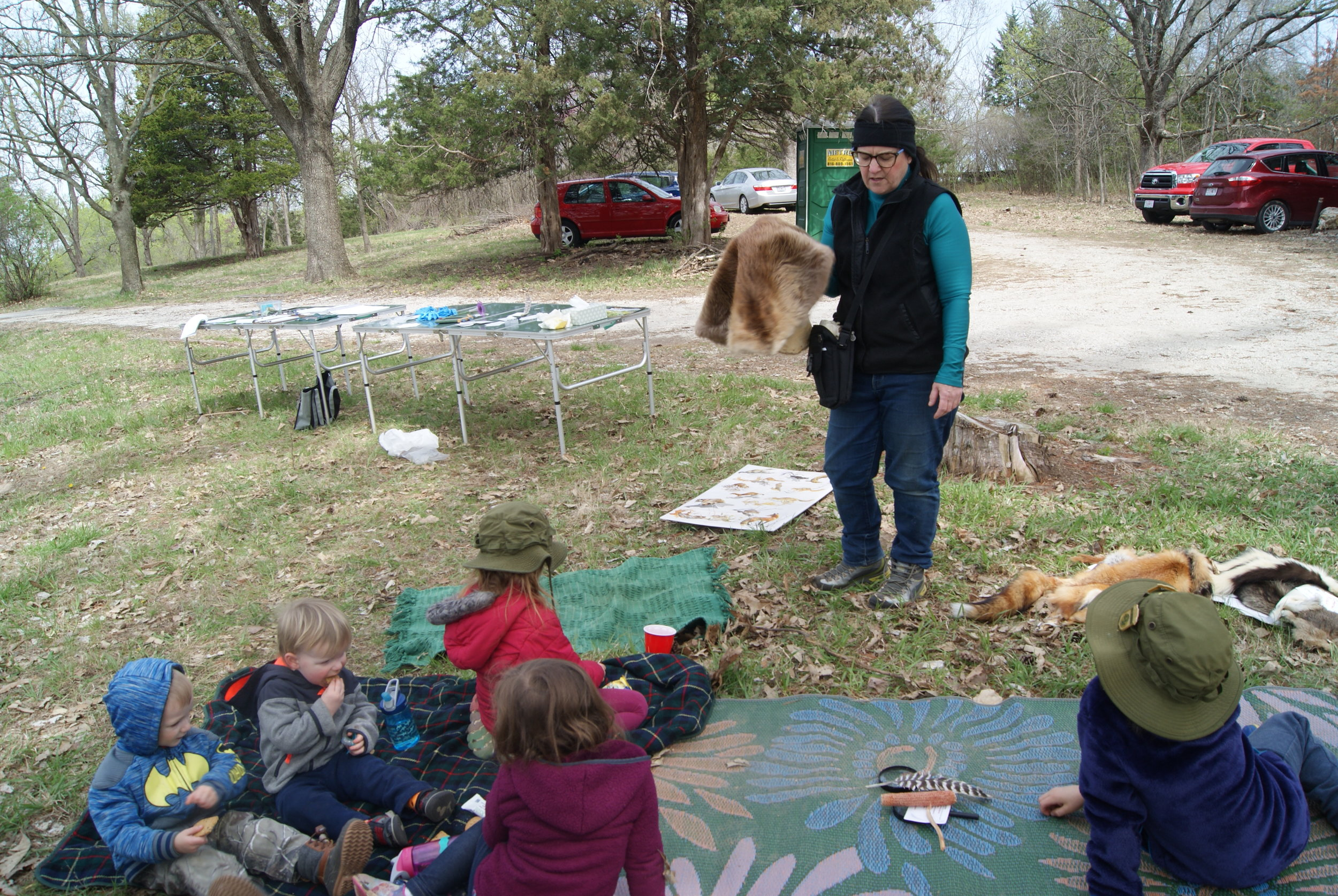 "MICHAEL CRIPE/Citizen photo The Platte Land Trust held a ""family time outdoors"" event Saturday, April 13 at the Charlotte Sawyers Nature Area in Parkville. Missouri Department of Conservation representative Mary Beth Ogle told children about various animals by showing them pelts."