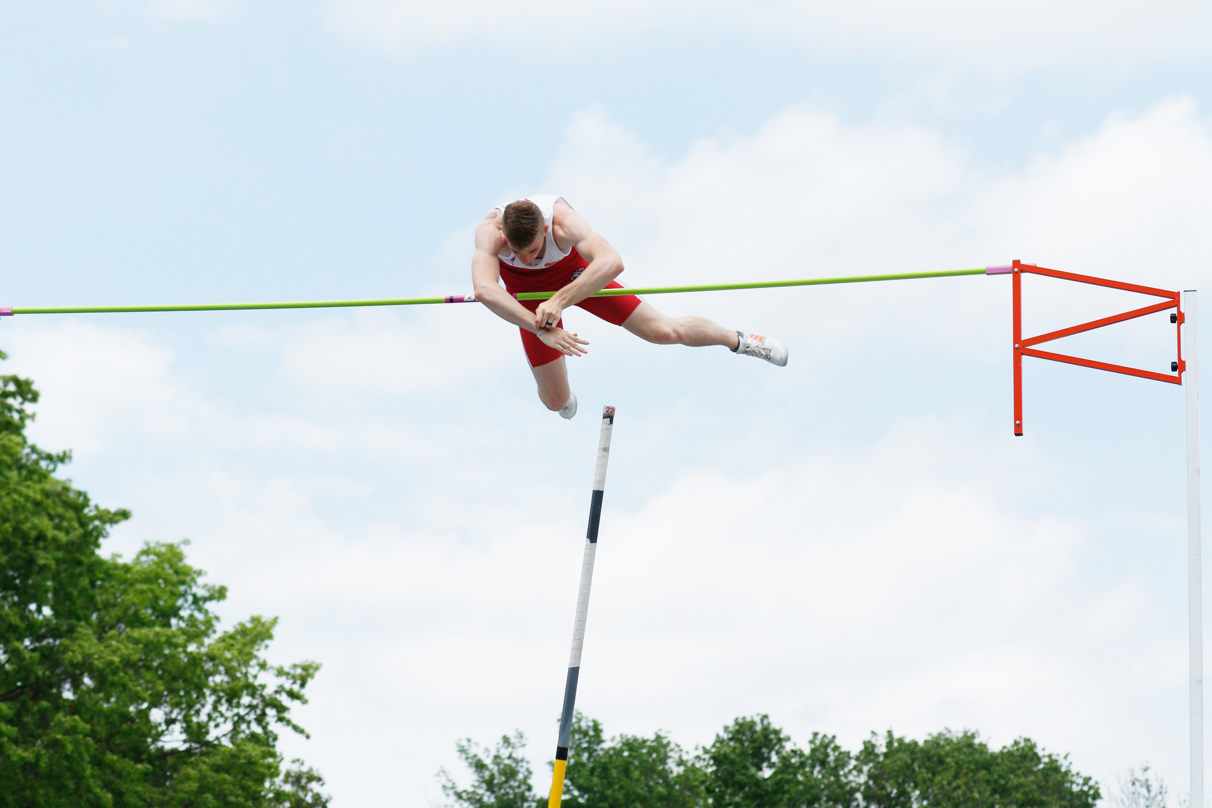 BILL POWELL/South Dakota Athletics Park Hill graduate and South Dakota junior Chris Nilsen, shown clearing the bar at a meet earlier this year, jumped 19 feet, 1 inch on Saturday, April 20, to become the world leader in the event, as well as the highest mark in the NCAA.
