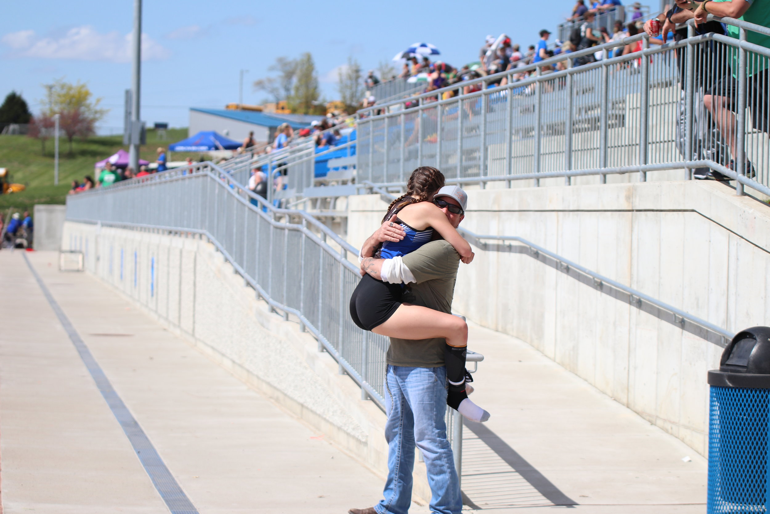 CODY THORN/Citizen photo  West Platte senior Ashlynne Crockett jumps into the arms of her father, Karl Crockett, after her relay team advanced to sectionals by taking second in the 4x400-meter relay on Saturday, May 4 in the Class 2 District 7 meet in Weston.
